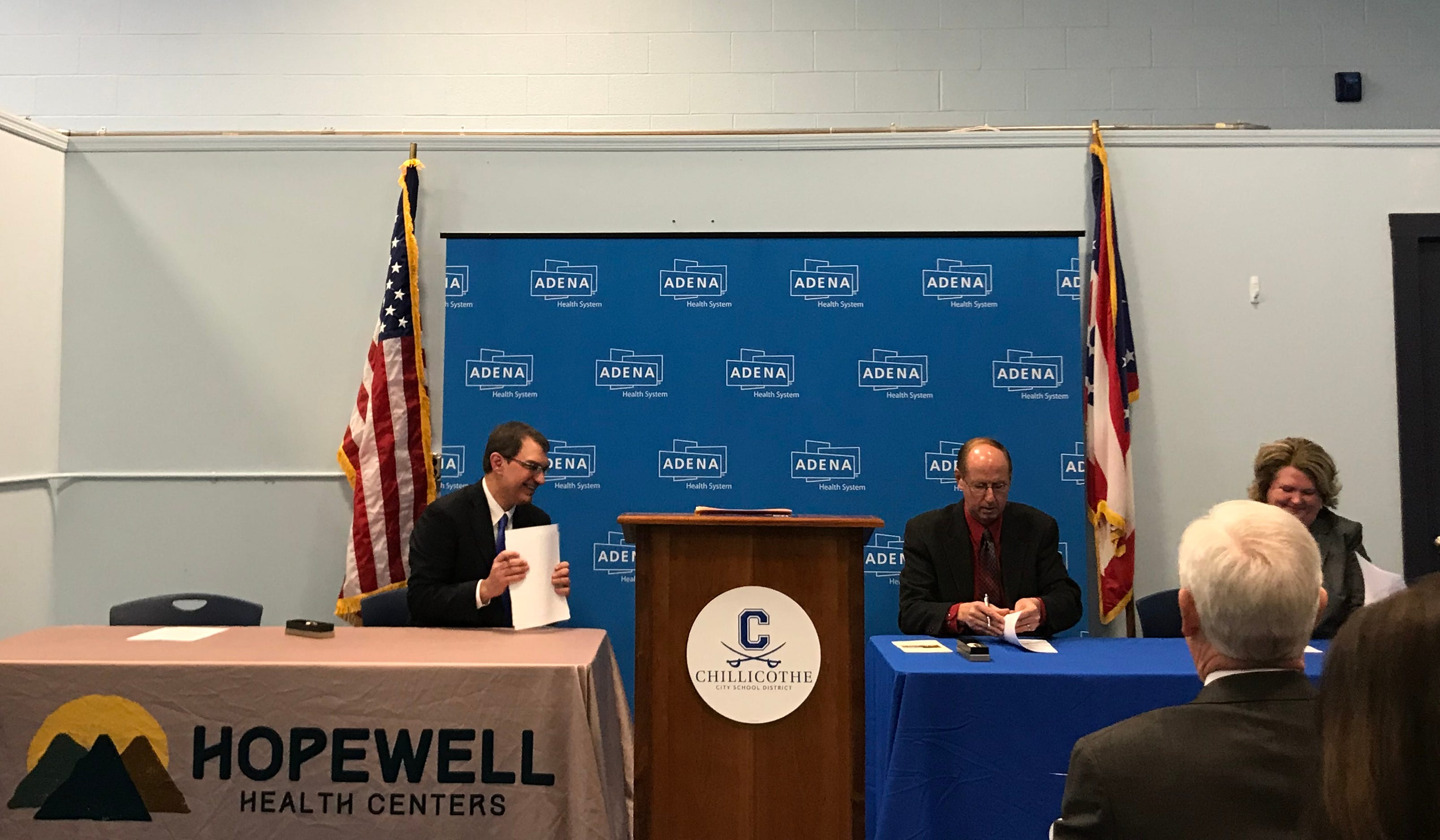 President and CEO of Hopewell Health, Mark Bridenbaugh, school board president Steve Mullins and treasurer Debroah Lawwell during the lease signing.