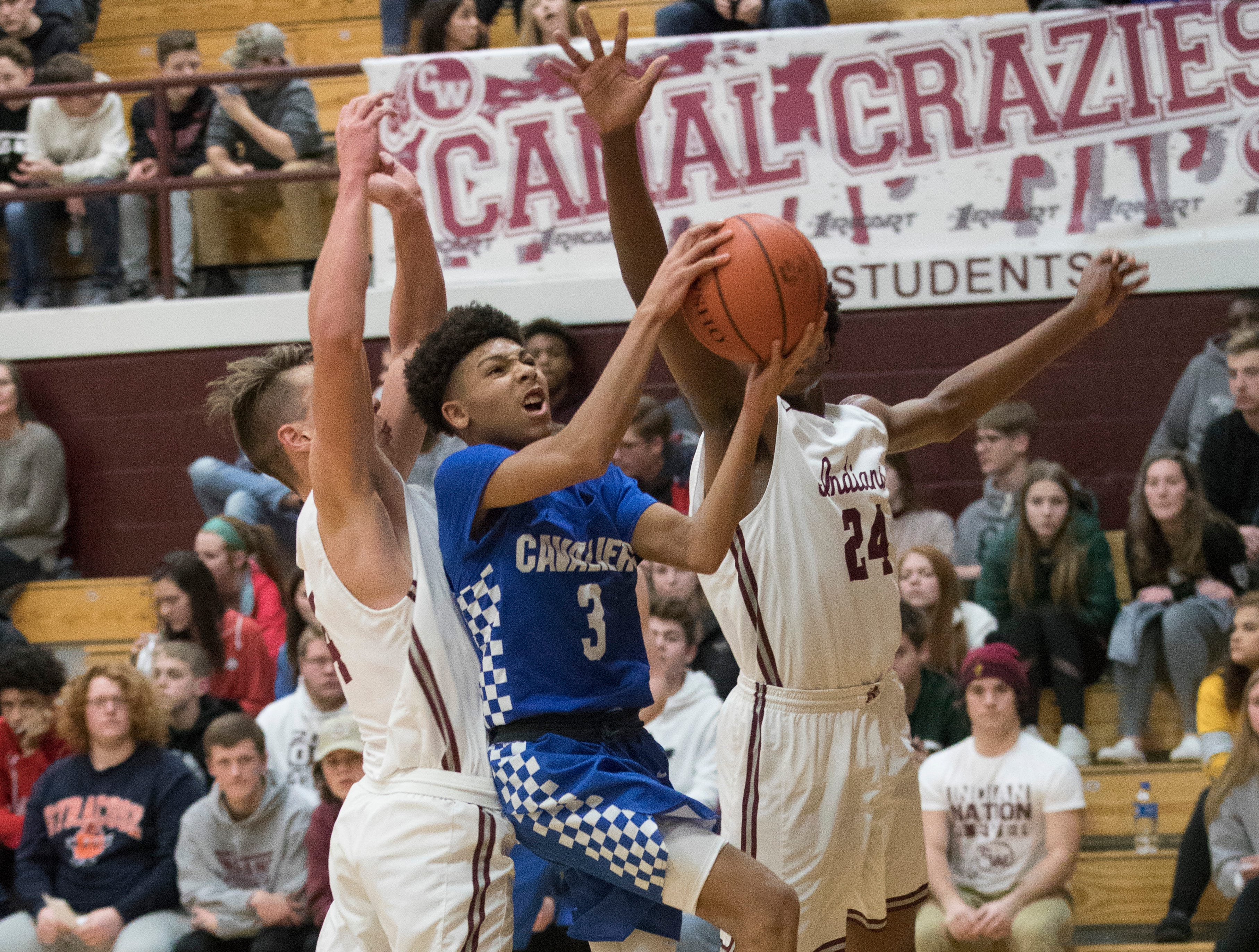 Junior Tre Beard jumps to score against Canal Winchester Wednesday night in Canal Winchester, Ohio. Beard scored 17 points for the Cavaliers.