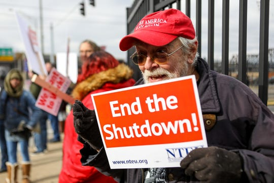 Tom Miller, Covington citzen and father of a government employee, stands and chants with protestors of the government shutdown. Government employees, National Treasury  Employee Unions members and citizens gather in Covington, KY outside of the IRS building to protest the government shutdown on Thursday Jan, 10, 2019.