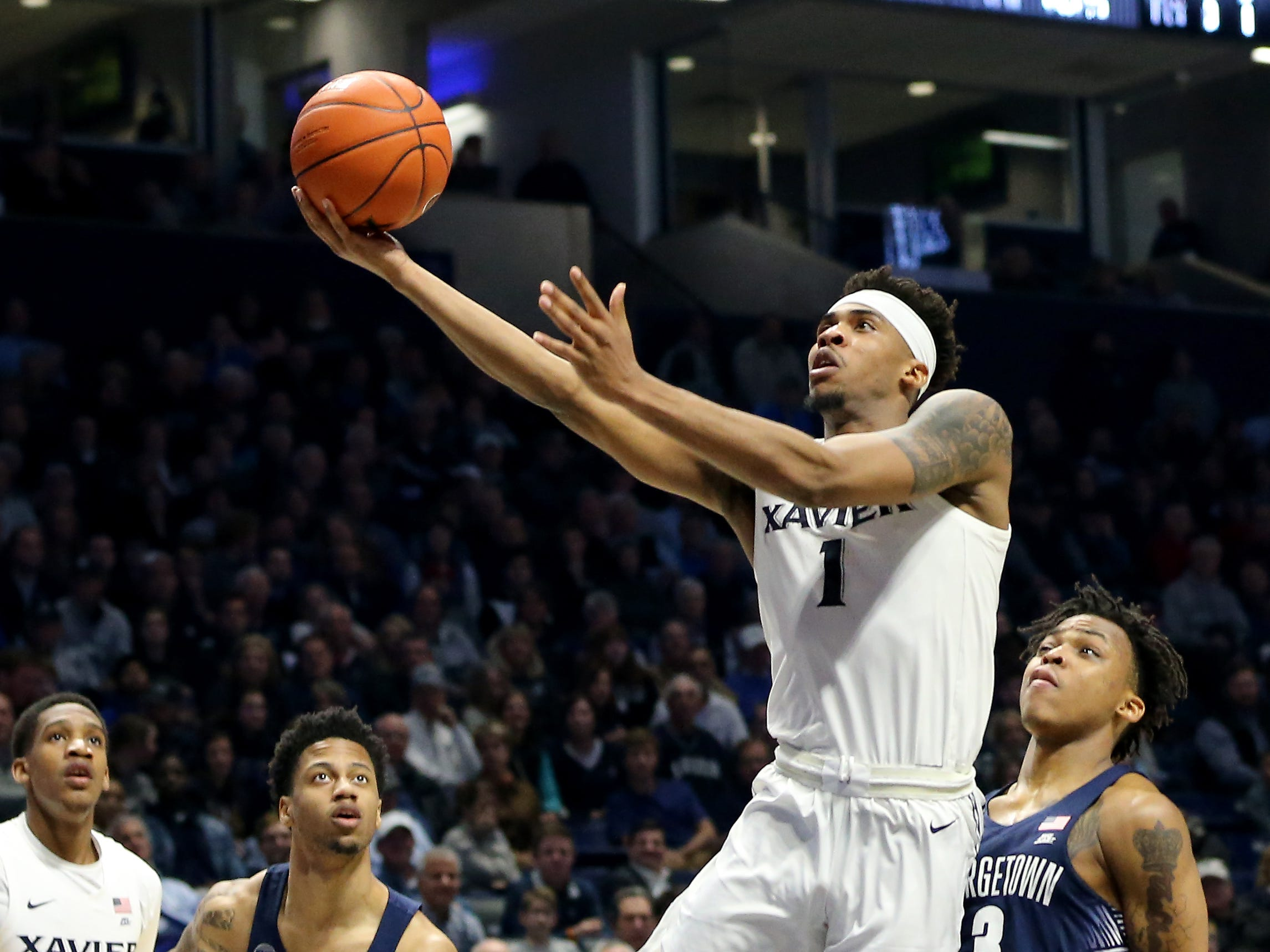 Xavier Musketeers guard Paul Scruggs (1) drives to the basket in the second half of an NCAA basketball game Georgetown Hoyas, Wednesday, Jan. 9, 2019, at the Cintas Center in Cincinnati. Xavier Musketeers won 81-75 against the Georgetown Hoyas.