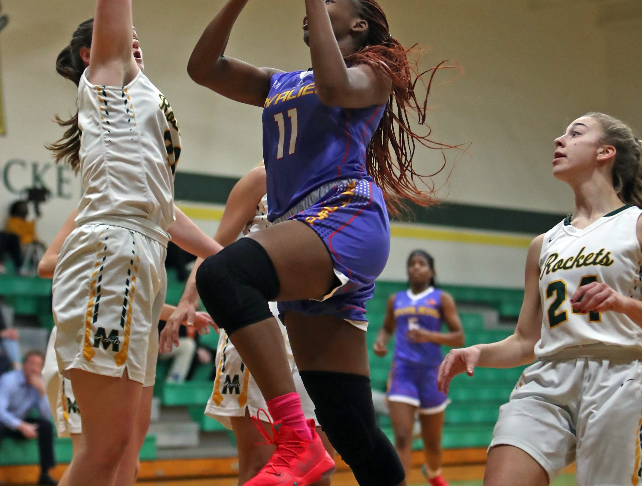 Purcell Marian guard Kya Dukes drives to the rim and scores Jan. 9 against McNicholas.