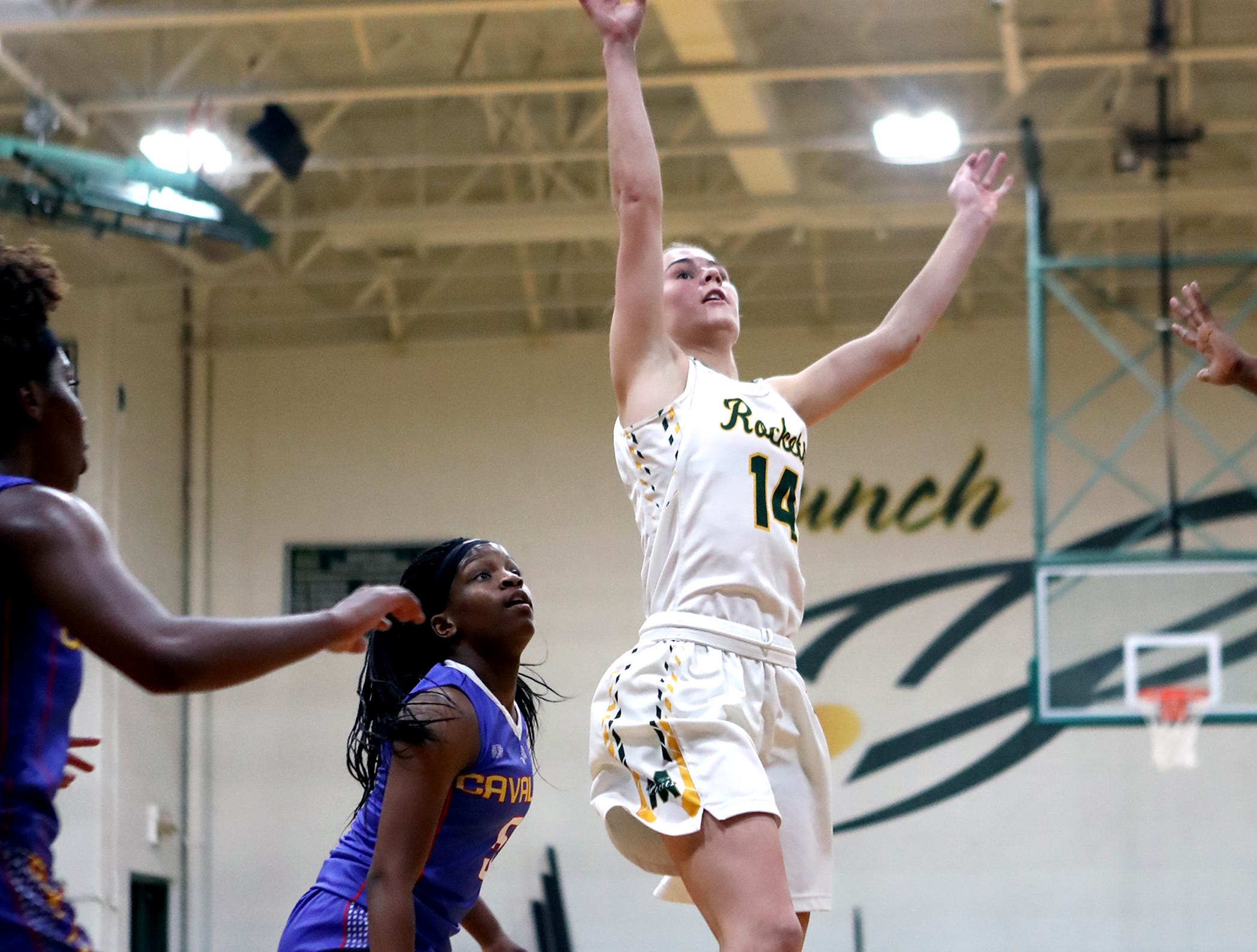 McNicholas guard Emily Byrne scores on a lay up. McNicholas upset Purcell 51-50 Jan. 9 in Greater Catholic League Coed action.