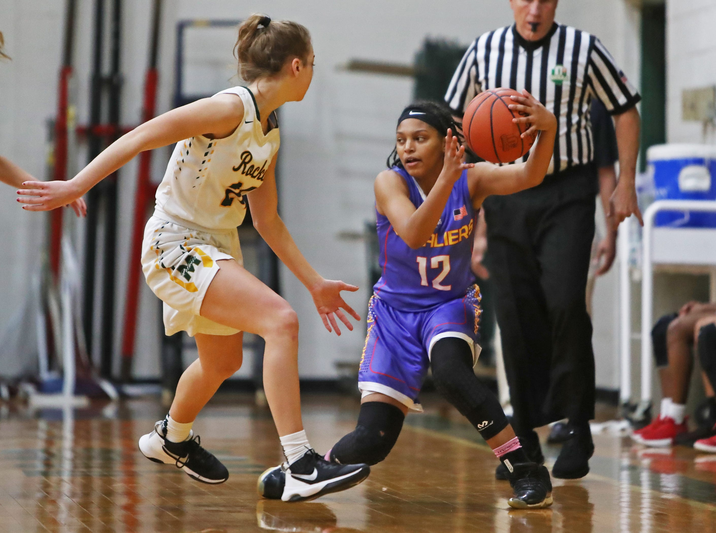 Purcell guard Santia Cravens looks for a teammate to help out. McNicholas upset Purcell 51-50 Jan. 9.