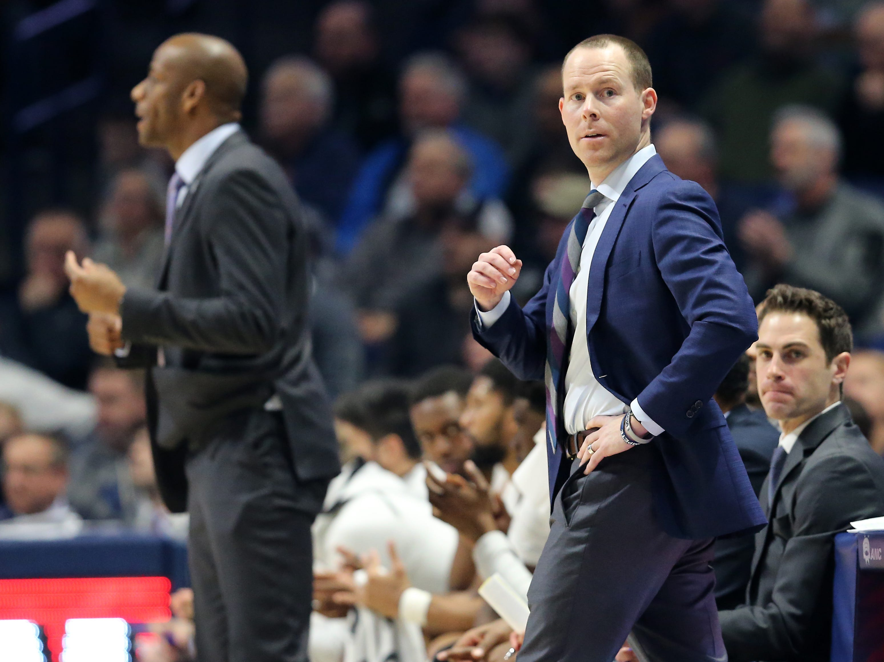 Xavier Musketeers head coach Travis Steele looks down toward the Georgetown Hoyas bench in the first half of an NCAA basketball game, Wednesday, Jan. 9, 2019, at the Cintas Center in Cincinnati.