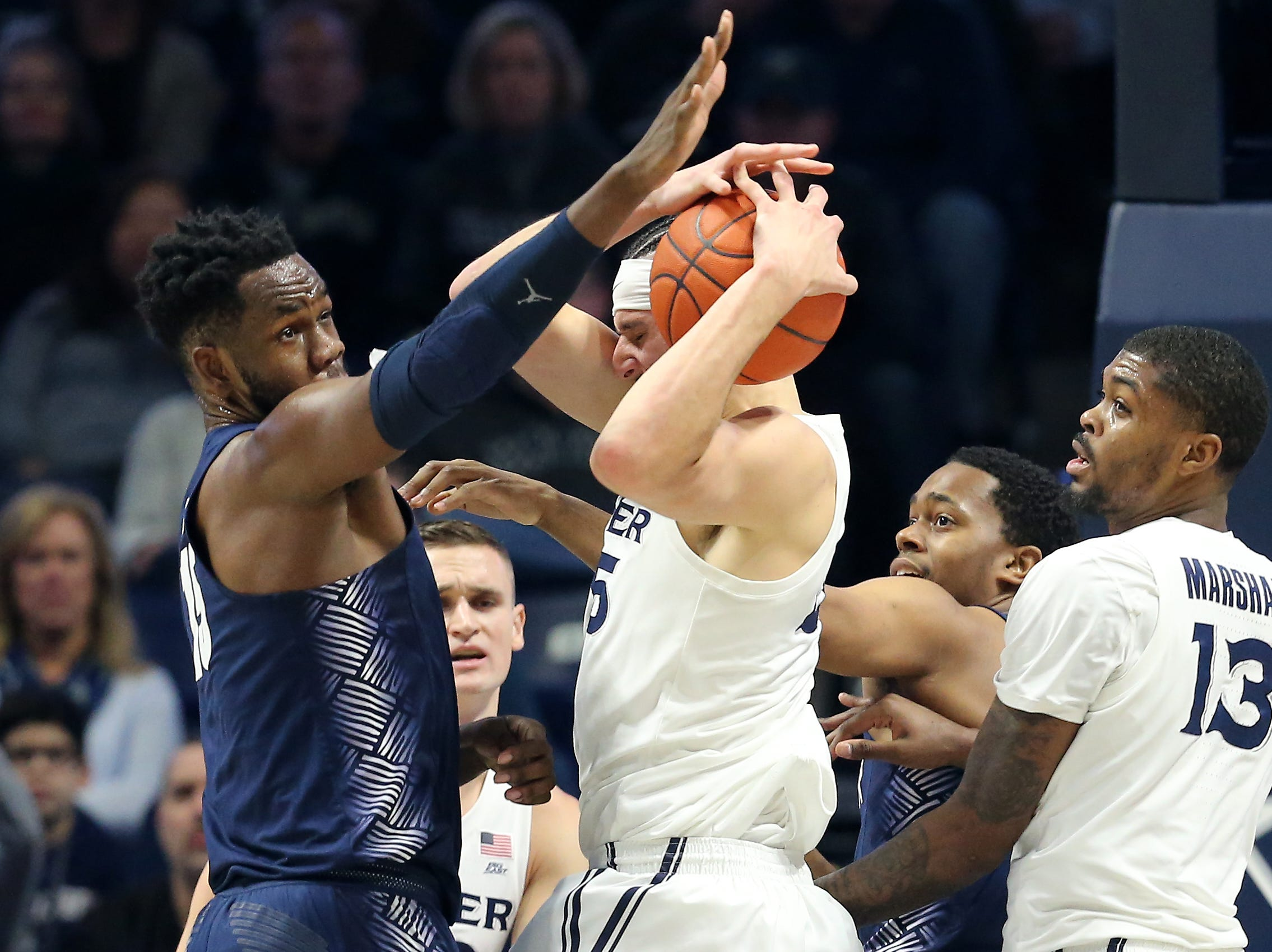 Xavier Musketeers forward Zach Hankins (35) collects a rebound in the first half of an NCAA basketball game against the Georgetown Hoyas, Wednesday, Jan. 9, 2019, at the Cintas Center in Cincinnati.