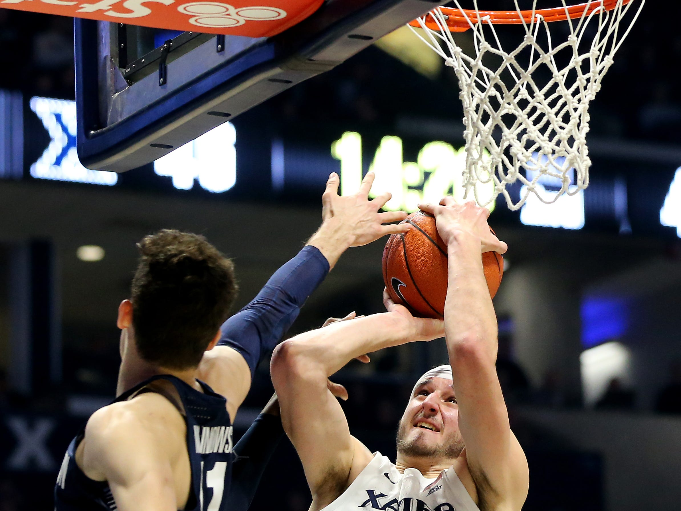 Xavier Musketeers forward Zach Hankins (35) goes for a shot as Georgetown Hoyas guard Greg Malinowski (11) defends in the second half of an NCAA basketball game, Wednesday, Jan. 9, 2019, at the Cintas Center in Cincinnati. Xavier Musketeers won 81-75 against the Georgetown Hoyas.