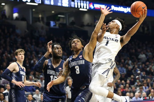 Xavier Musketeers guard Paul Scruggs (1) drives to the basket as Georgetown Hoyas guard James Akinjo (3) in the second half of an NCAA basketball game, Wednesday, Jan. 9, 2019, at the Cintas Center in Cincinnati. Xavier Musketeers won 81-75 against the Georgetown Hoyas.