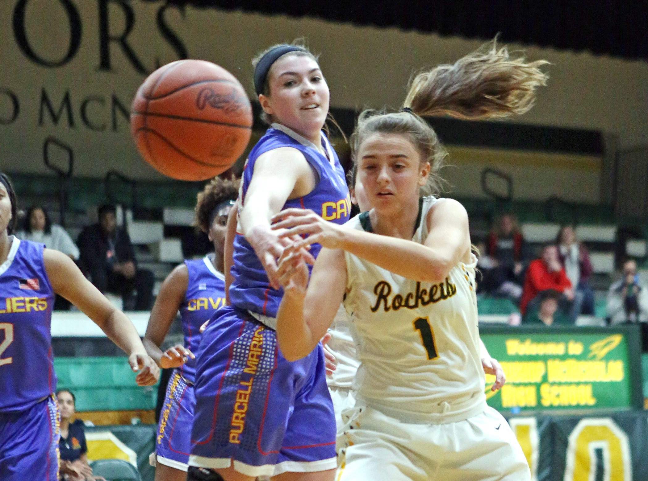 McNicholas guard Emma McSwigan tries to get control of the ball. McNicholas upset Purcell 51-50.