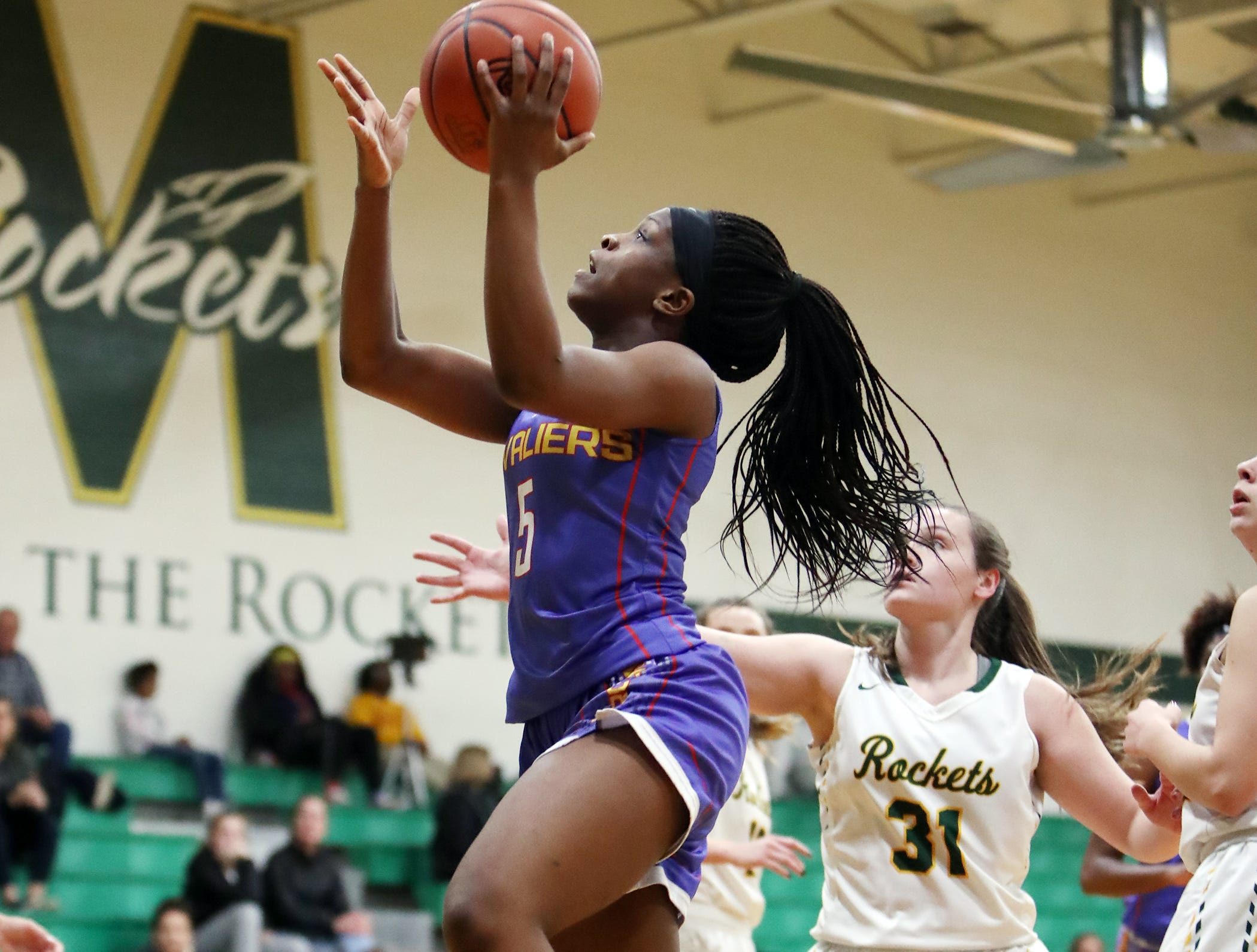 Purcell forward Sha'Dai Hale drives and scores. McNicholas upset Purcell 51-50 Jan. 9.