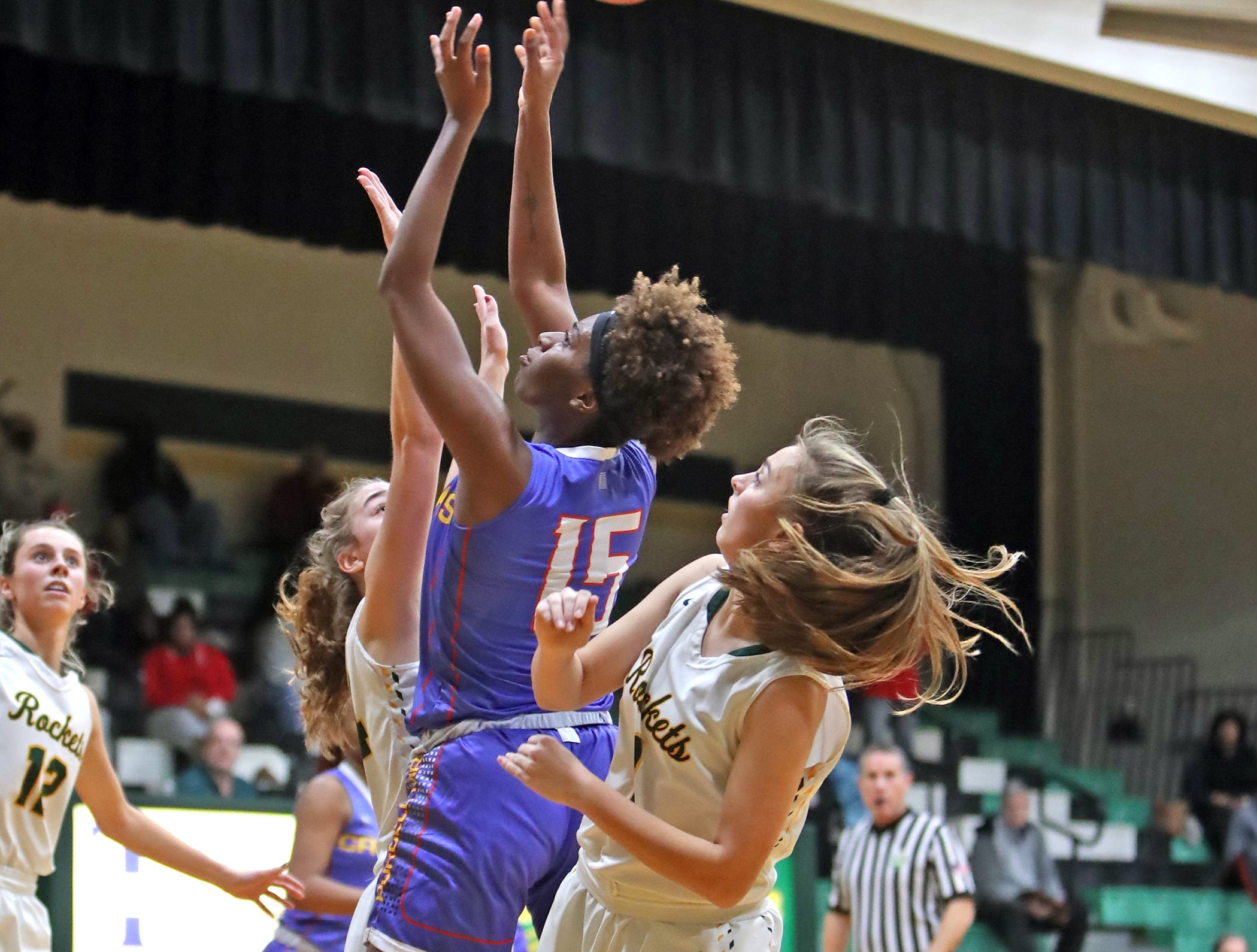Purcell Marian guard Sha'Dai Hale attempts to score from the lane. McNicholas upset Purcell 51-50.