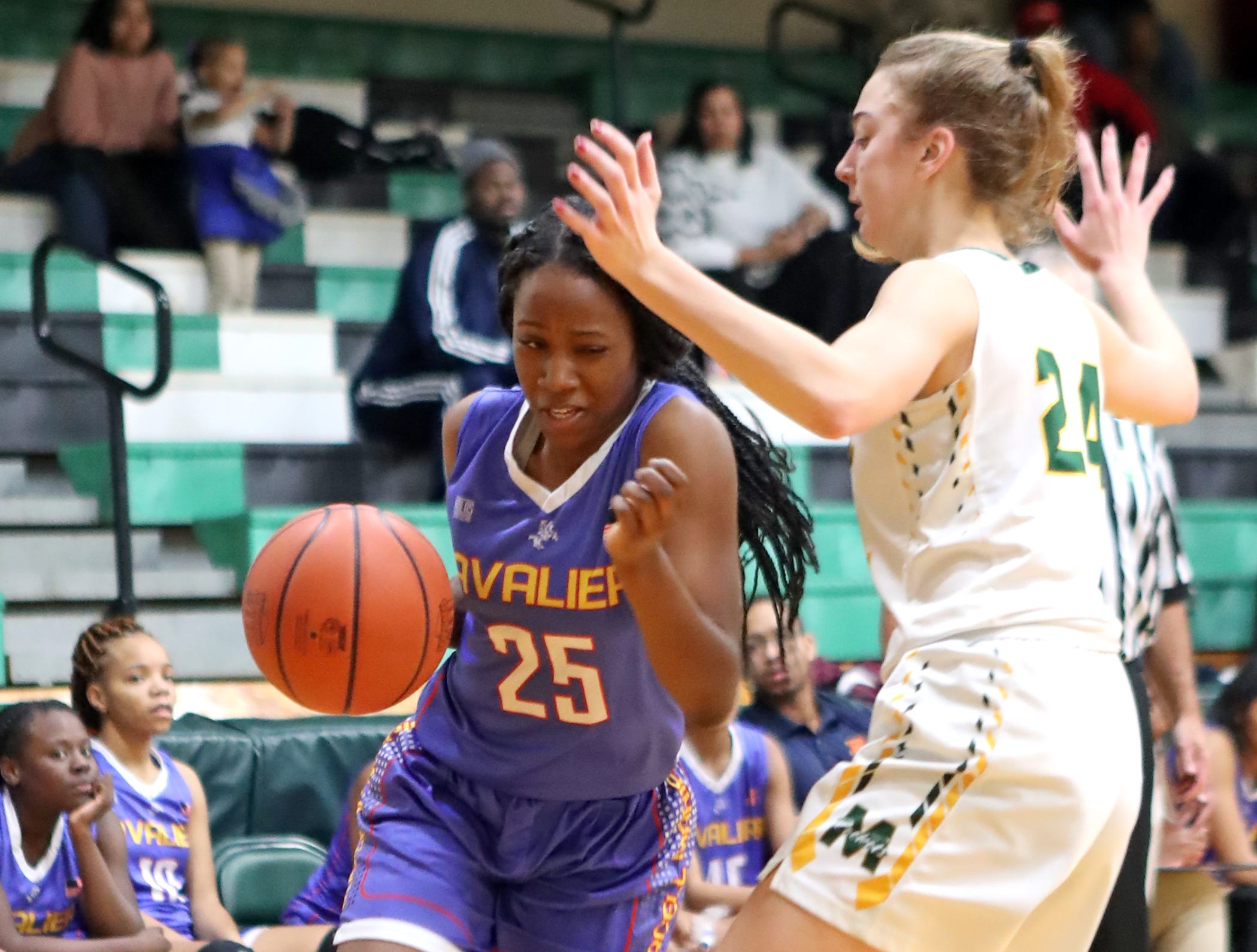 Purcell Marian guard Jaimone Jones attempts to drive the base line. McNicholas upset Purcell 51-50.