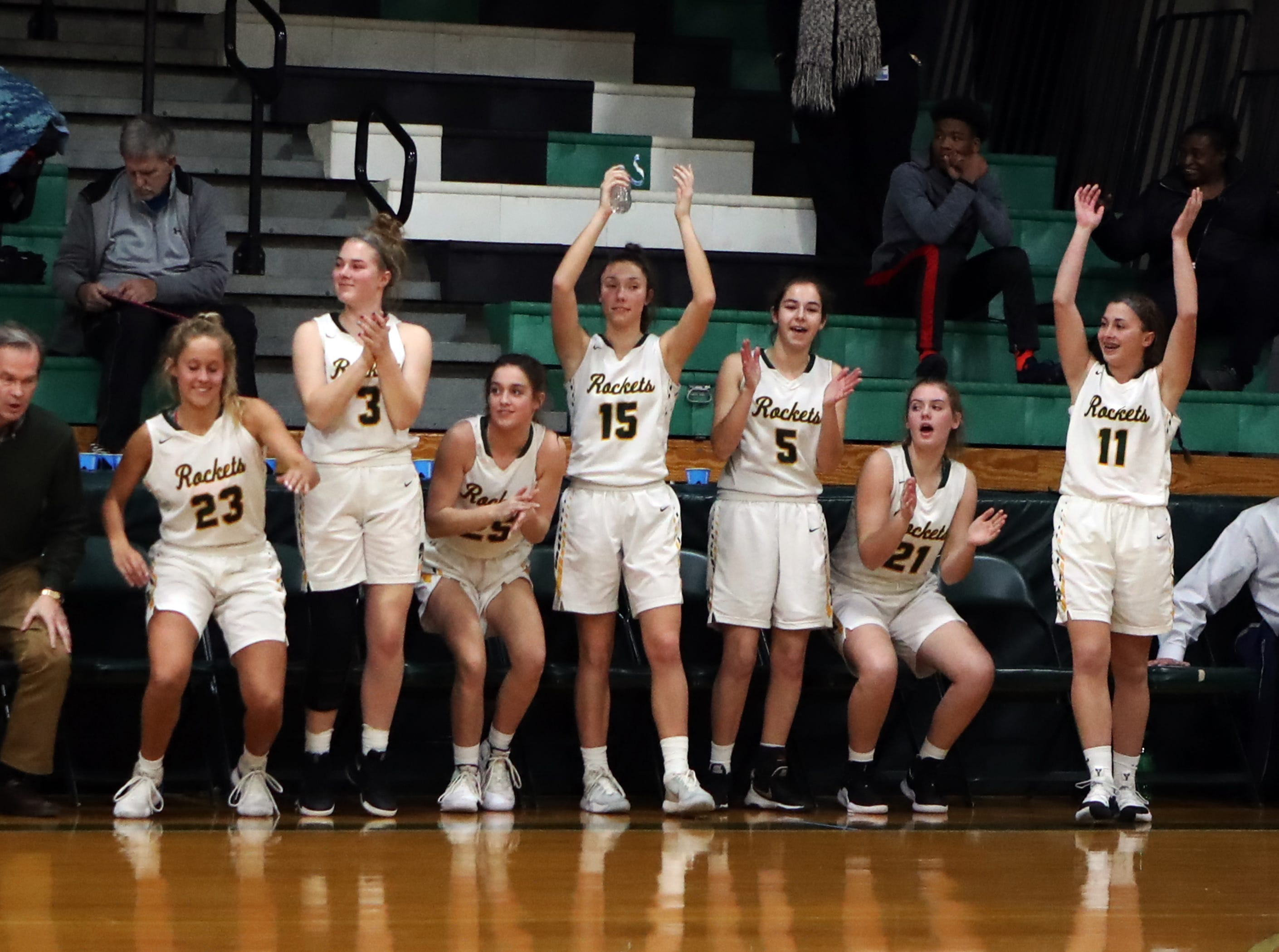 The McNicholas bench celebrates as time runs out. McNicholas upset Purcell 51-50.