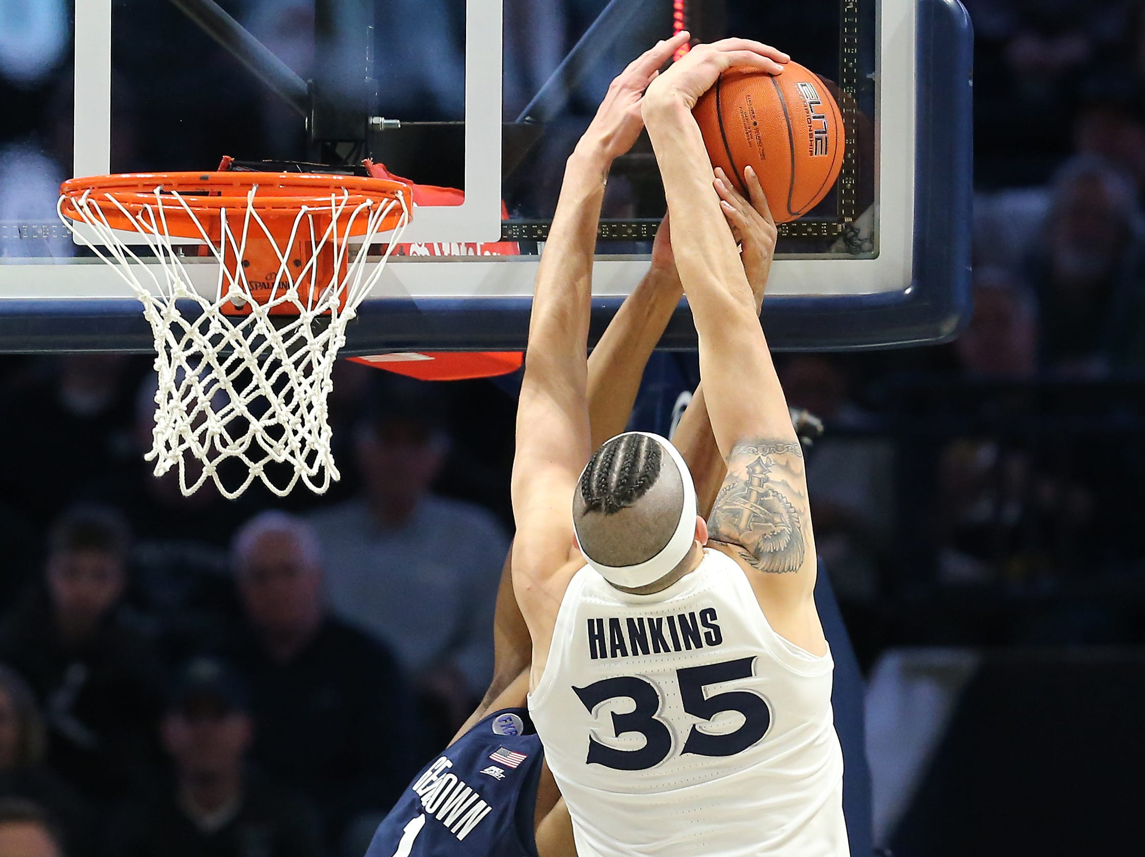 Xavier Musketeers forward Zach Hankins (35) blocks a shot by Georgetown Hoyas guard Jamorko Pickett (1) in the first half of an NCAA basketball game, Wednesday, Jan. 9, 2019, at the Cintas Center in Cincinnati.