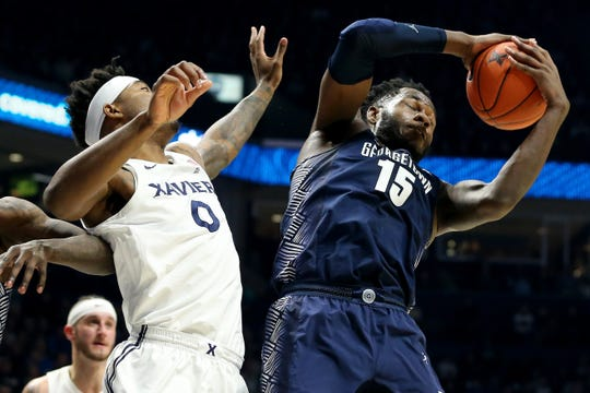 Georgetown Hoyas center Jessie Govan (15) pulls down a rebound over Xavier Musketeers forward Tyrique Jones (0) in the first half of an NCAA basketball game, Wednesday, Jan. 9, 2019, at the Cintas Center in Cincinnati.
