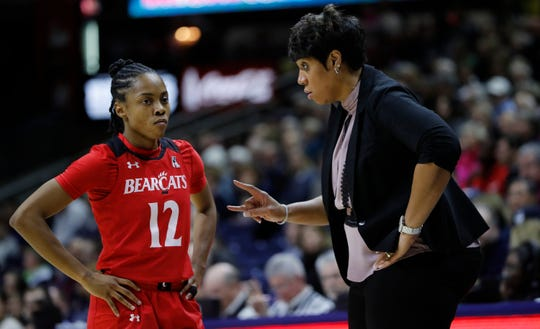 Cincinnati Bearcats head coach Michelle Clark-Heard talks with guard Antoinette Miller, who scored a career-high 25 points in a WNIT loss to TCU on Sunday, March 31, 2019.