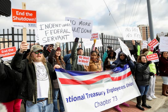 Government employees, National Treasury  Employee Unions members and citizens gather in Covington, KY outside of the IRS building to protest the government shutdown on Thursday Jan, 10, 2019.