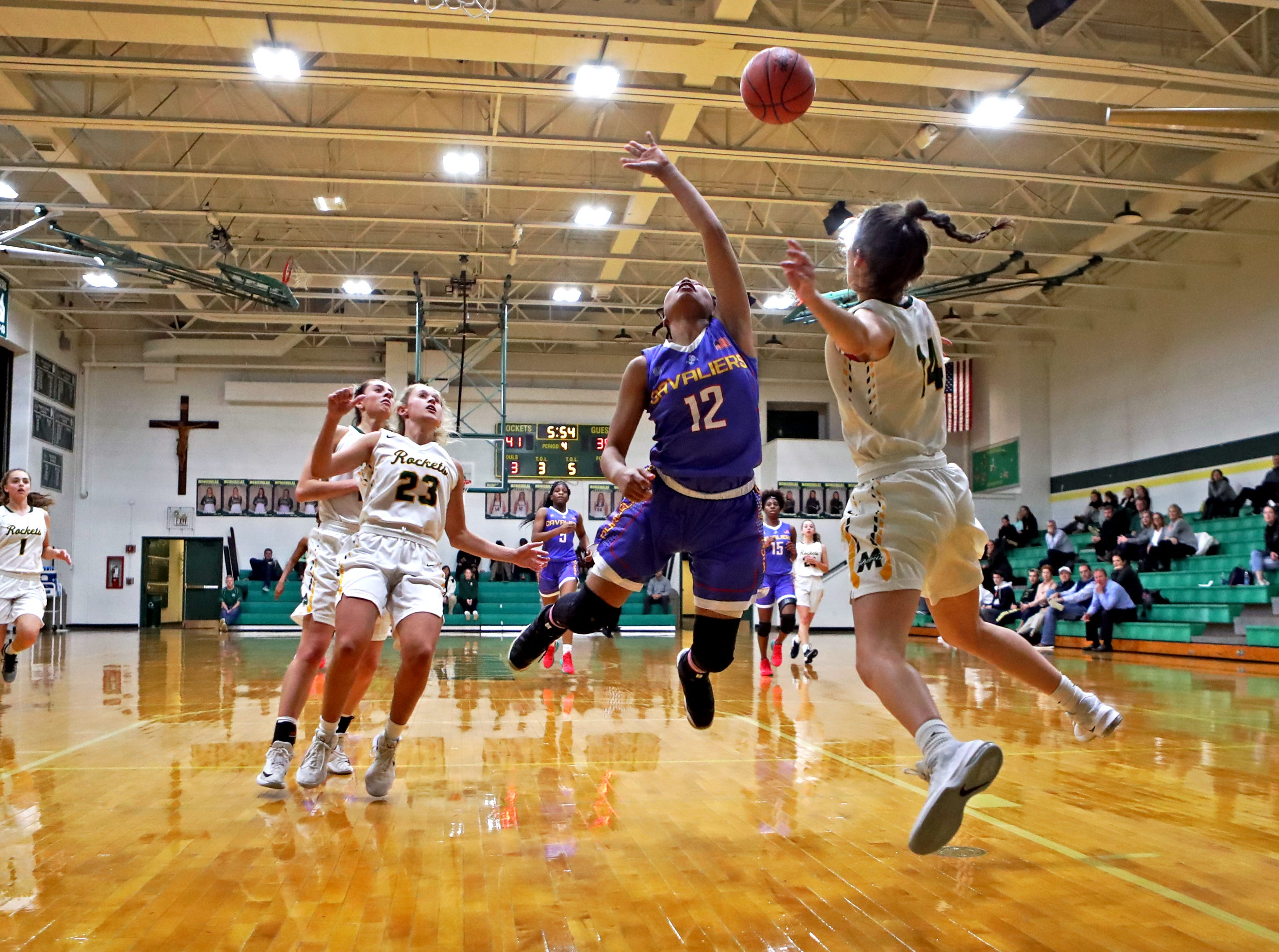 Purcell Marian guard Santia Cravens attempts to score from the lane. McNicholas upset Purcell 51-50.