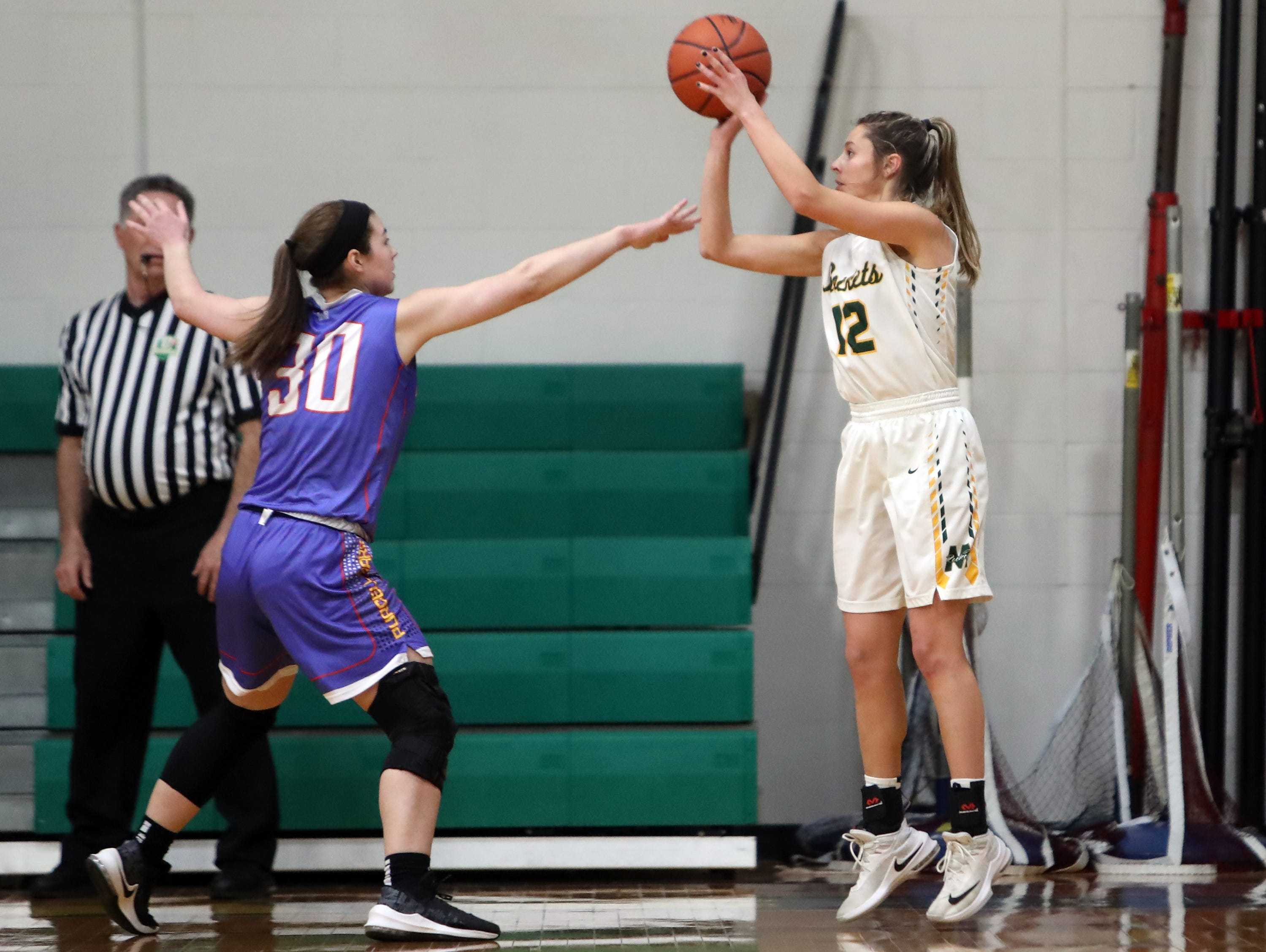 McNicholas guard Liz Huber knocks down a three-point basket for the Rockets.