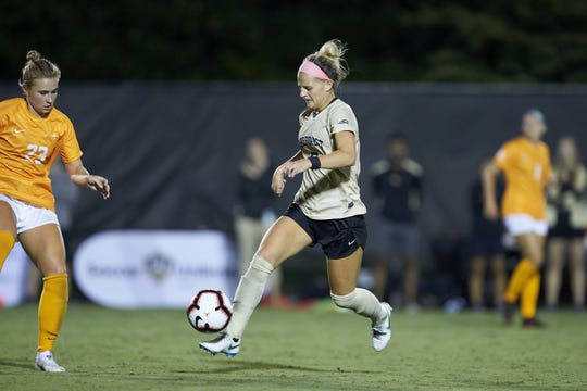 Bayley Feist (9) of the Wake Forest Demon Deacons chases after the ball during he second overtime period against the Tennessee Volunteers at W. Dennie Spry Stadium on the campus of Wake Forest University on Aug. 23, 2018, in Winston-Salem, North Carolina.  The Demon Deacons and the Volunteers played to a 1-1 draw.