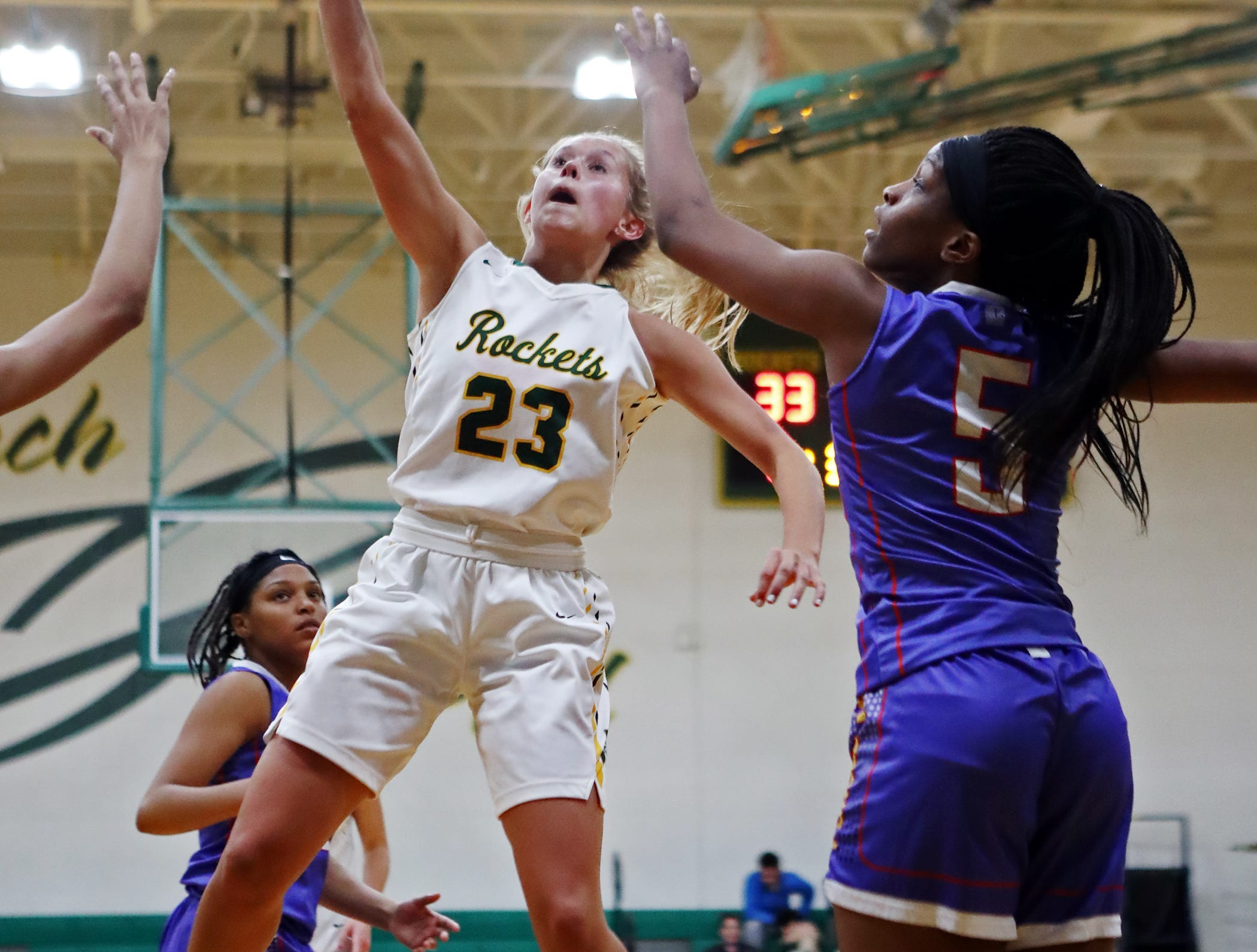 McNicholas forward Christina Poole drives and scores. McNicholas upset Purcell 51-50.