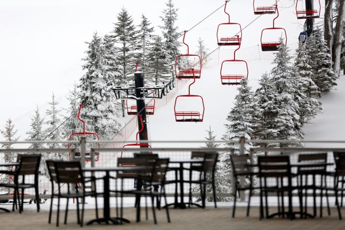 Snow blows onto the slops at Perfect North ahead of re-opening in Lawrenceburg, Ind., on Thursday, Jan. 10, 2019. Operations were suspended on Jan. 8 for weather but are expected to resume Friday.