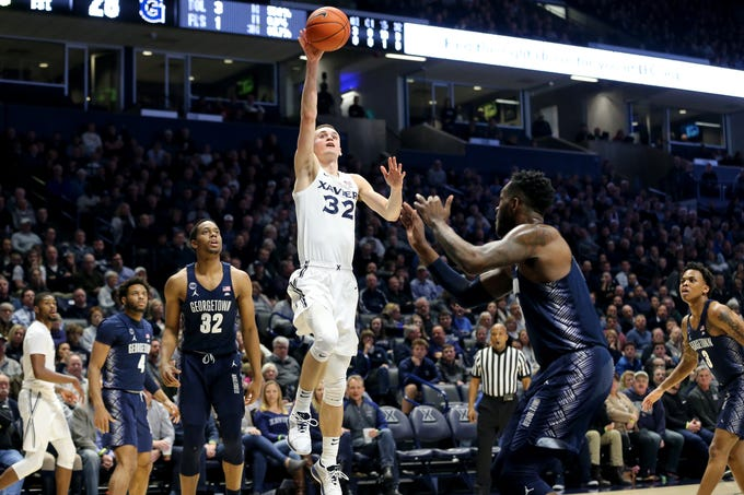 Xavier Musketeers forward Ryan Welage (32) rises for a shot in the first half of an NCAA basketball game against the Georgetown Hoyas, Wednesday, Jan. 9, 2019, at the Cintas Center in Cincinnati.