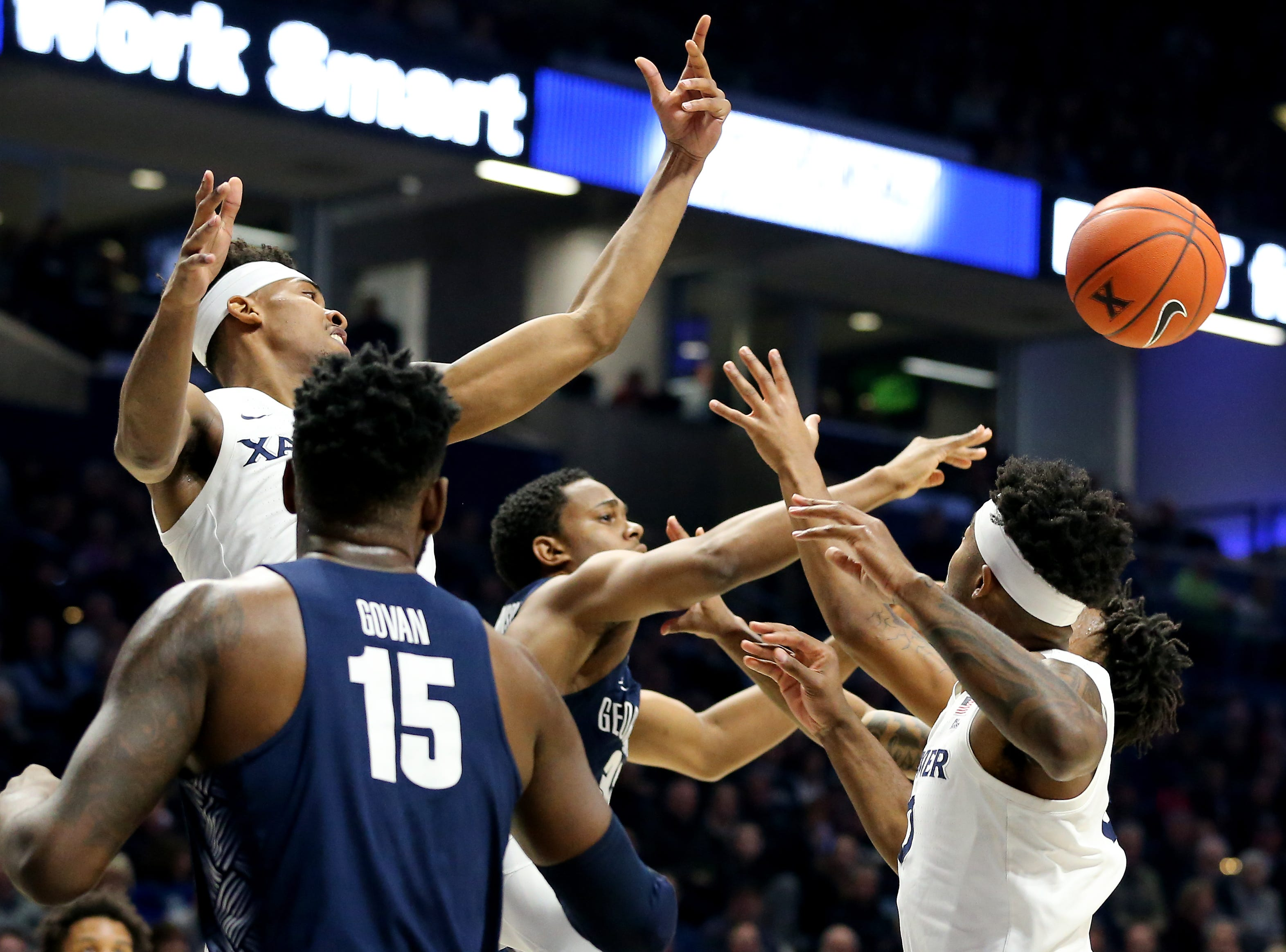 Xavier Musketeers guard Paul Scruggs (1) and Xavier Musketeers forward Tyrique Jones (0) reach for a rebound in the first half of an NCAA basketball game against the Georgetown Hoyas, Wednesday, Jan. 9, 2019, at the Cintas Center in Cincinnati.