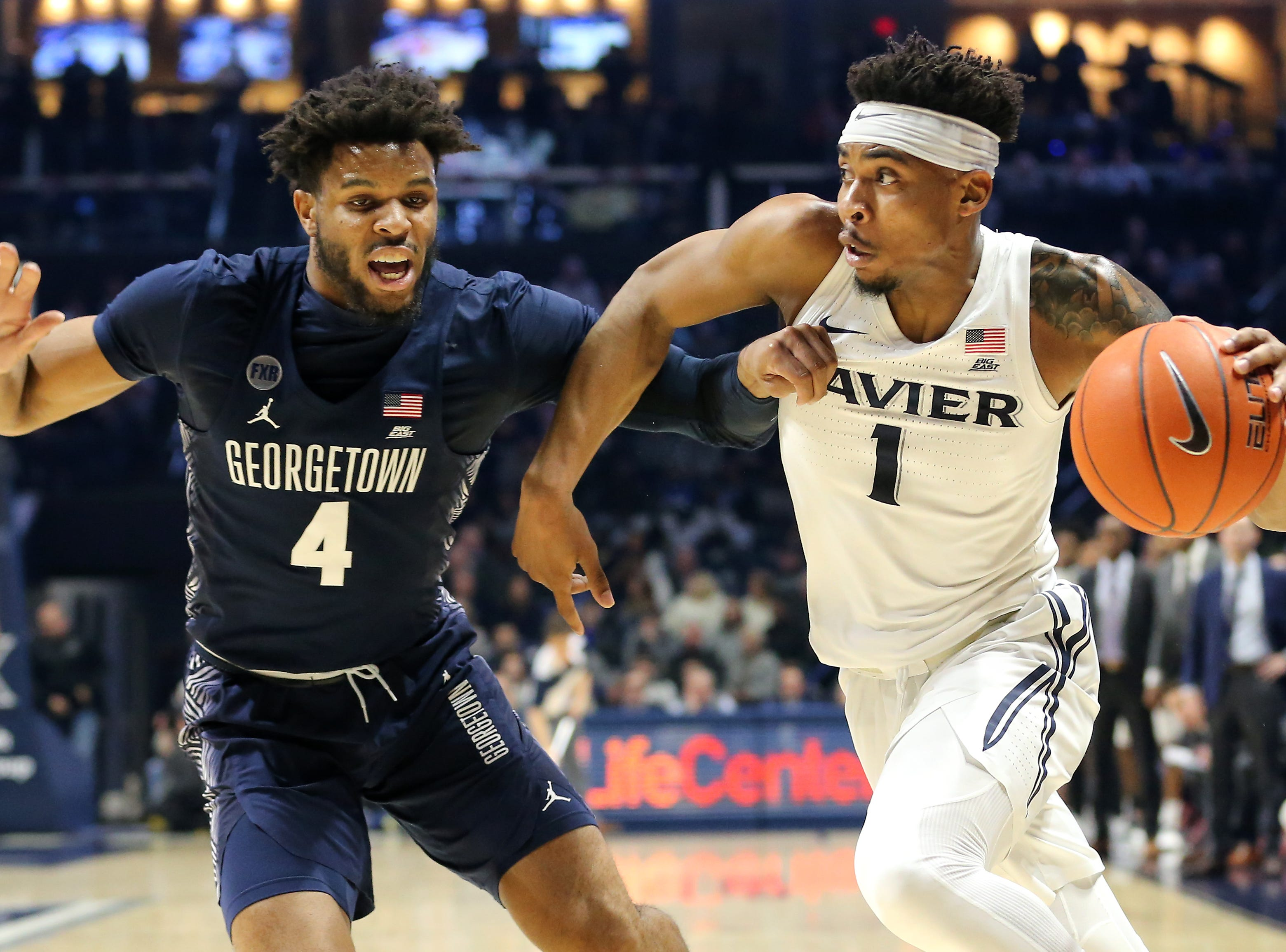 Xavier Musketeers guard Paul Scruggs (1) drives to the basket as Georgetown Hoyas guard Jagan Mosely (4) in the first half of an NCAA basketball game, Wednesday, Jan. 9, 2019, at the Cintas Center in Cincinnati.