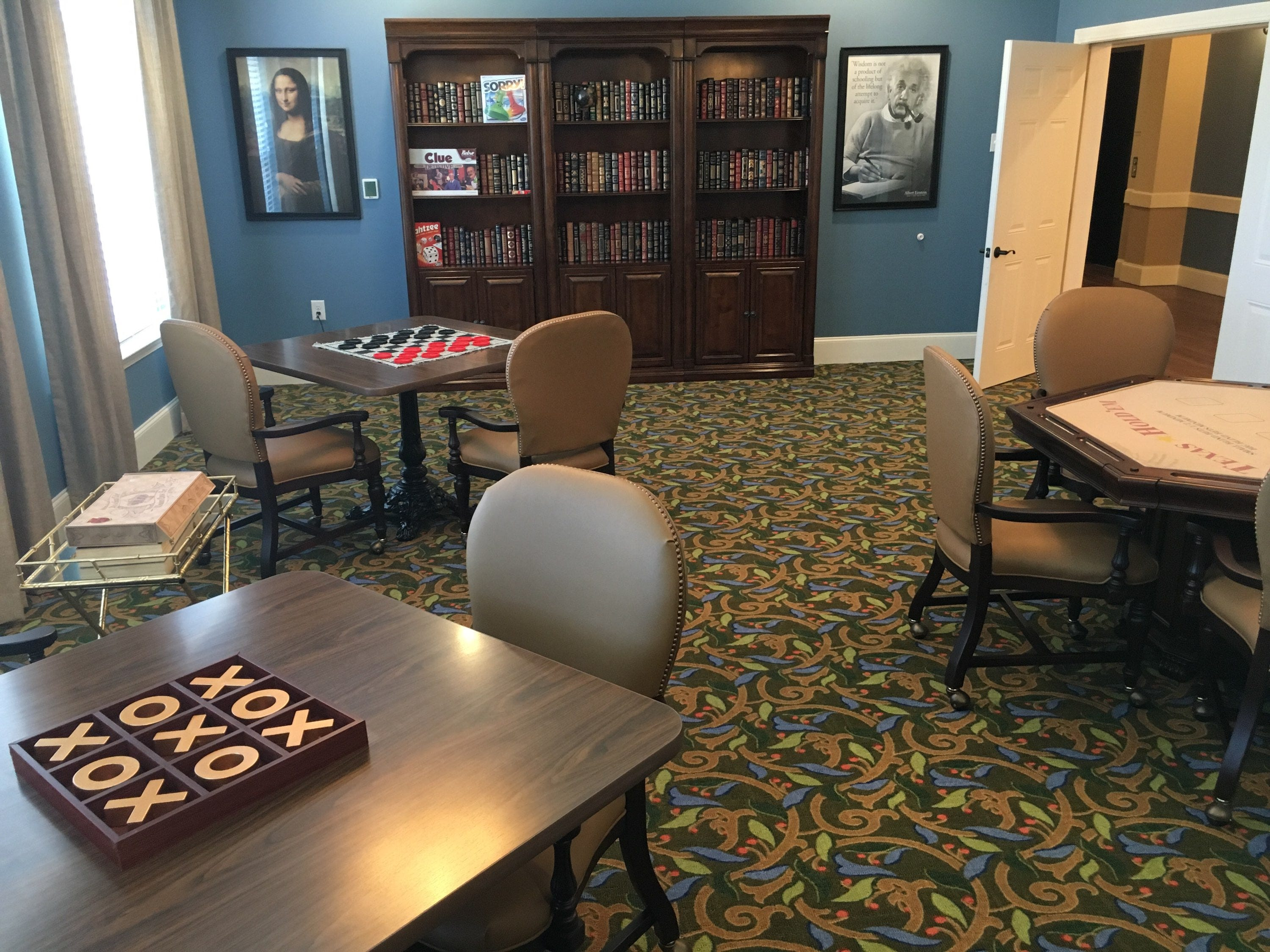 Library and game room at the Villages at the River Club.