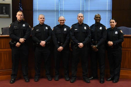 New Woodbridge police officers  Stephen Zimmerman, Neil Garrett, Robert Vanco, Andrew Kotarsky, Khari Manzini and Samantha Siana.