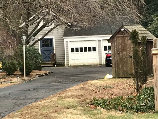 The garage area of a home on Farm Lane in Bound Brook where police were conducting a death investigation.