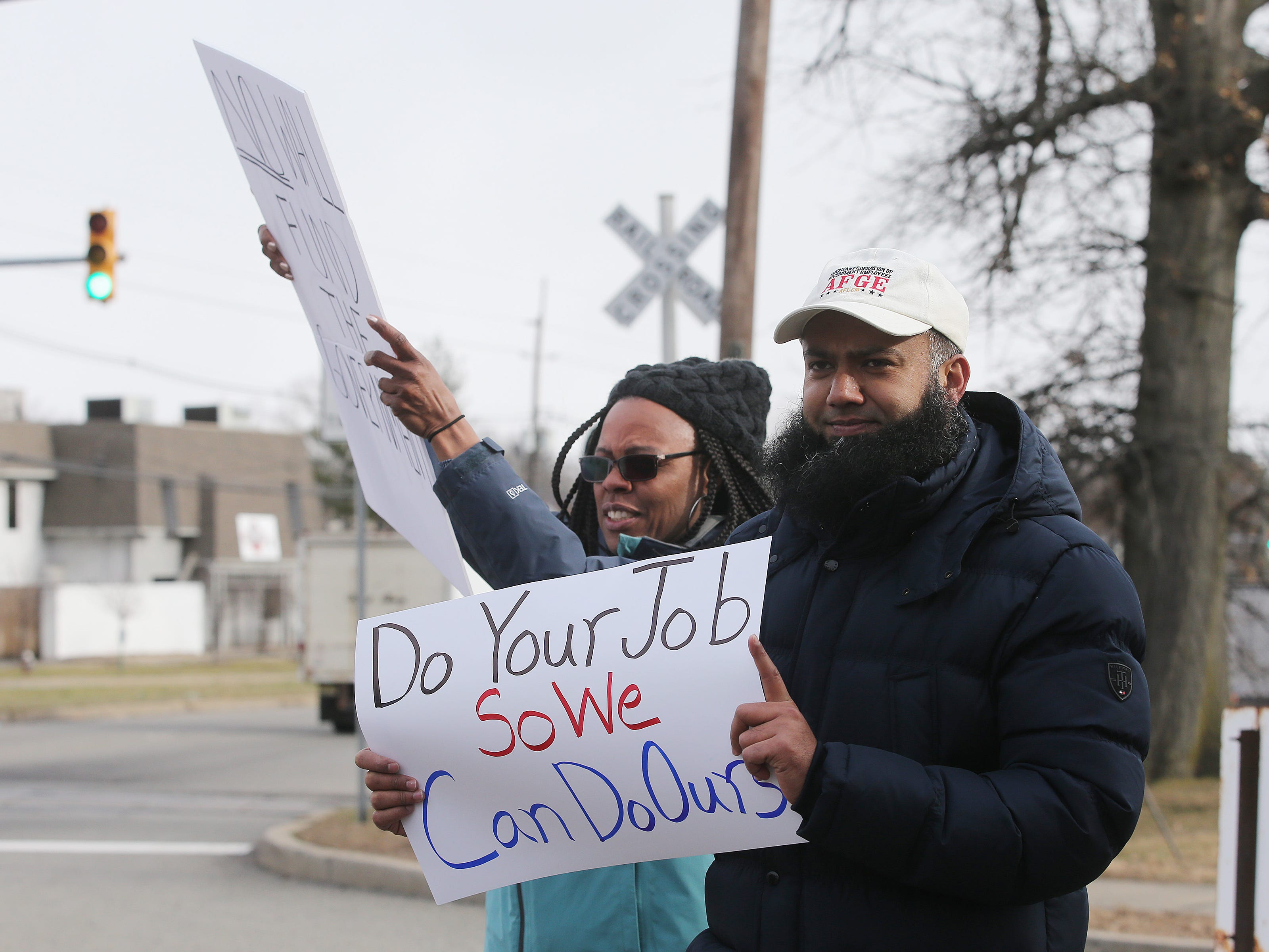 Muhammad Manj of Avenel, an EPA physical scientist, holds a sign as furloughed EPA workers protest government shutdown outside the Environmental Protection Agency in Edison, NJ Thursday January 10, 2019.