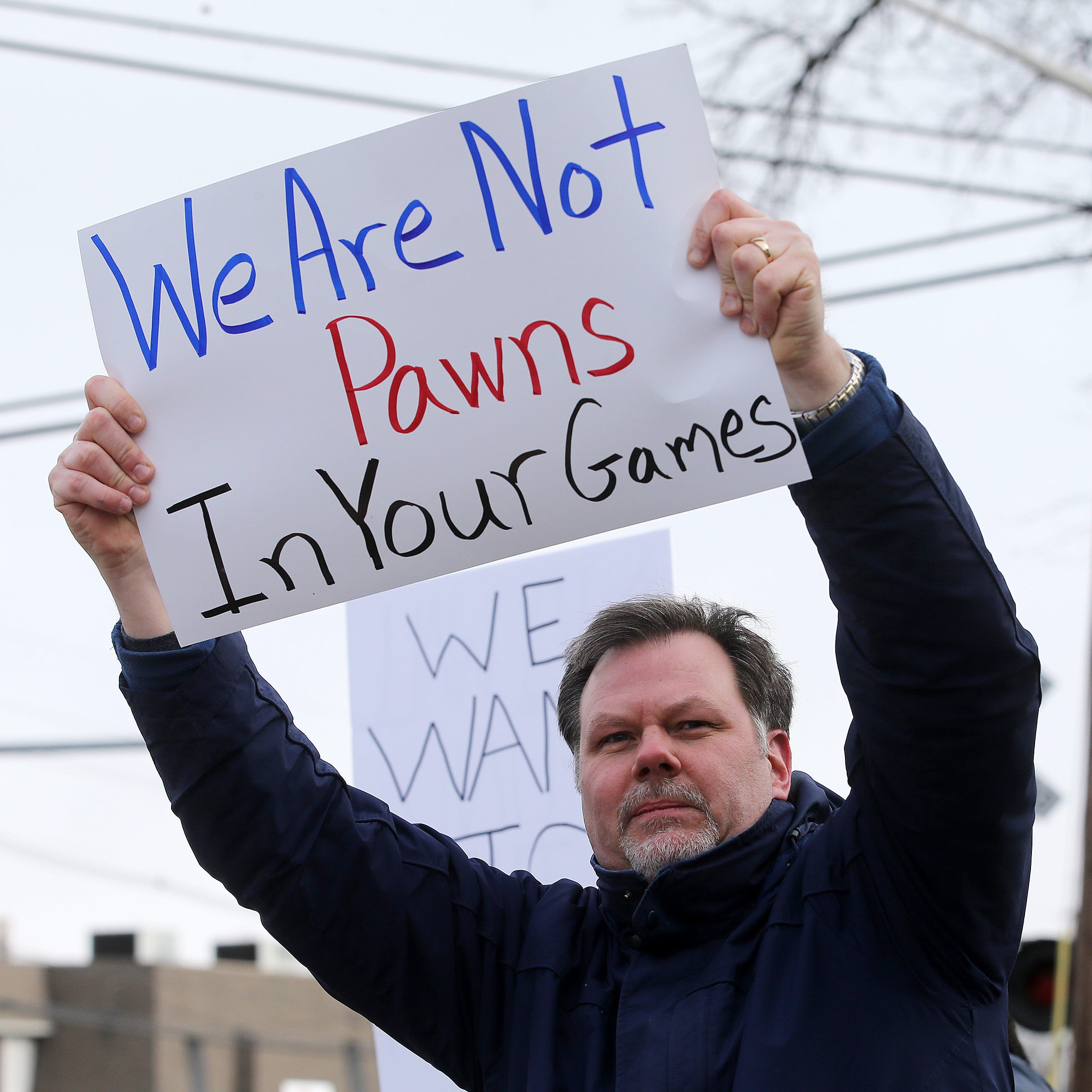Government shutdown: Federal workers rally for their jobs in NJ