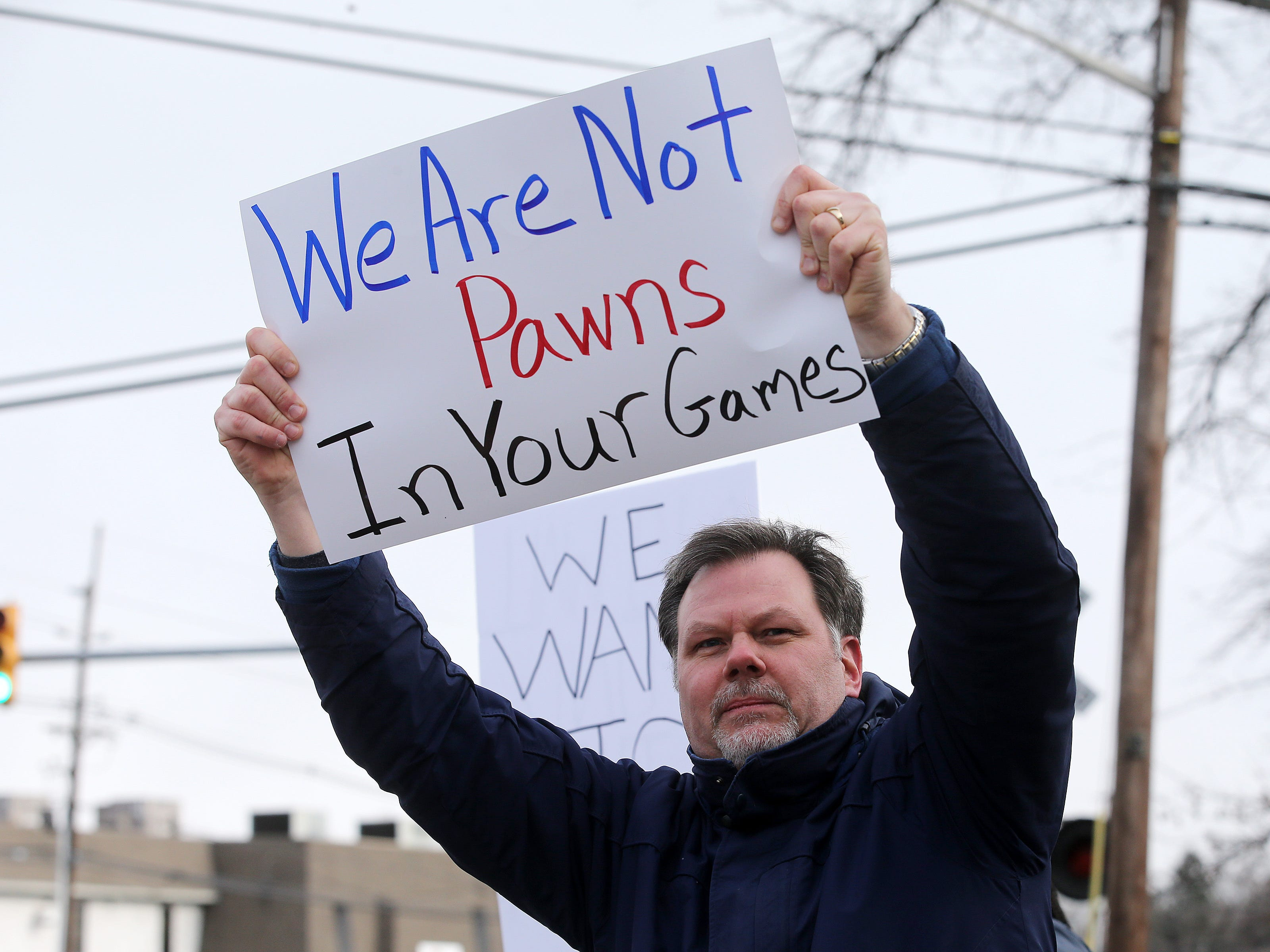 Edward J. Guster III of Fairless HIlls, Pennsylvania, an EPA environmental scientist, holds a sign as furloughed EPA workers protest government shutdown outside the Environmental Protection Agency in Edison, NJ Thursday January 10, 2019.