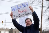 Furloughed EPA workers protest the government shutdown outside the Environmental Protection Agency in Edison.