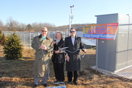 Symbolically cutting the power cord, are (left to right): John Killian, Renewable Energy Consultant, Eznergy;Tamra Campanella, administrative director, Hunterdon Health and Wellness Centers and Jim Brown, managing partner, Eznergy NJ, LLC.