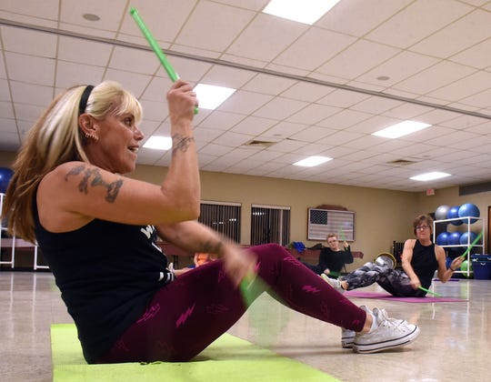 Pound Fit instructor Ellen Hardesty leads a class attended by Joni McClain and Melody Lowe on Wednesday, Jan. 9, 2019 at the Coshocton Senior Center.