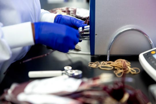 Maggie Isaac, a component technician II at LifeServe Blood Center, puts the final labels on bags of blood before they're moved to a cooler to then be distributed to hospitals, in the blood center's lab on Thursday, Jan. 10, 2019, in Des Moines. Under Iowa's new tax law many of the supplies LifeServe uses are now taxed causing them to pay more than a million dollars in taxes annually.