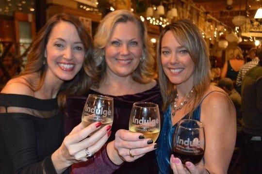 Indulge event-goers indulge in some wine.