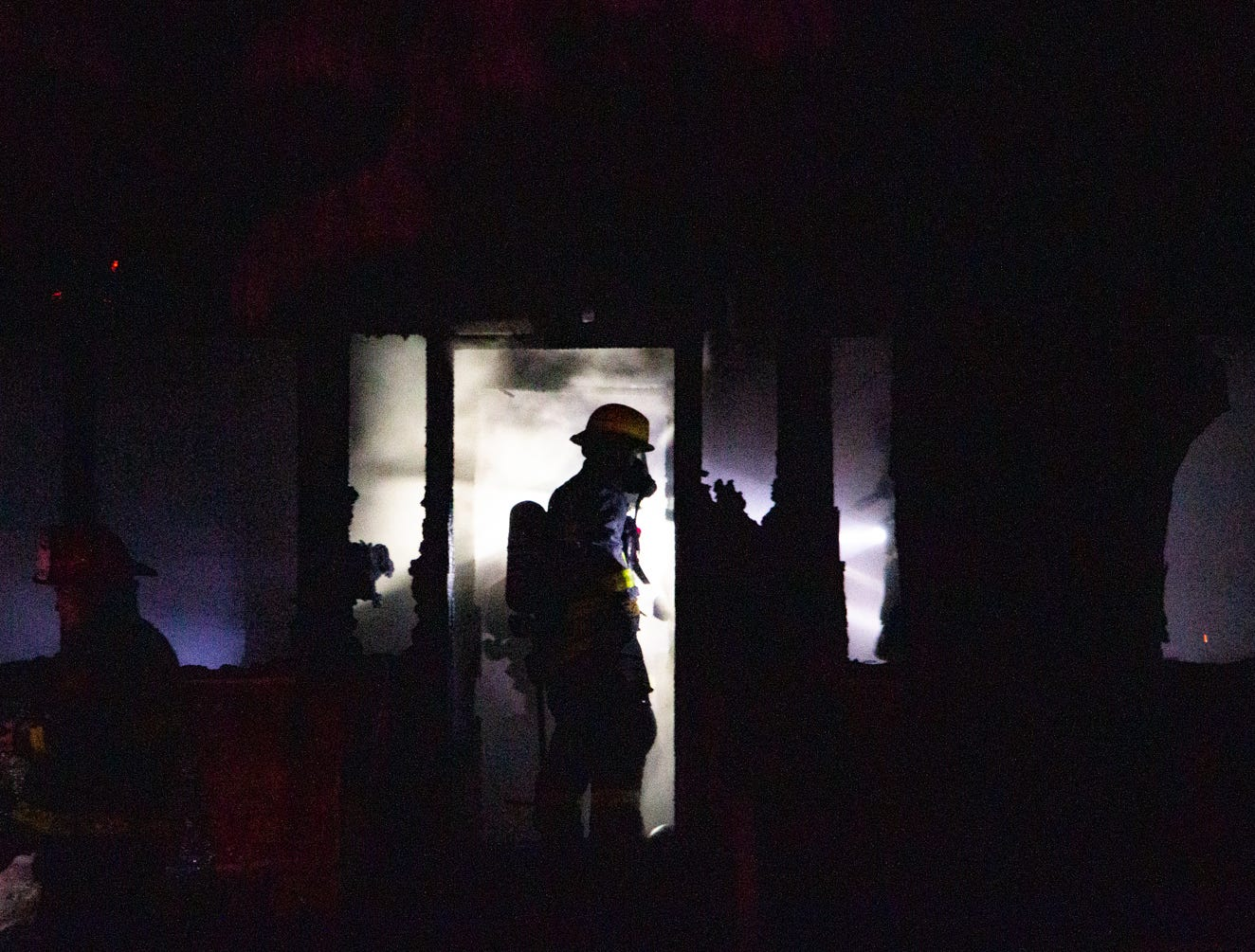Fire crews work among heavy smoke while searching for a man that was thought to still be in the house at 1113 37th Street on Wednesday, Jan. 9, 2018.