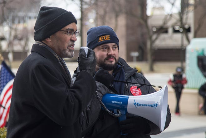 Wayne County Treasurer Eric Sabree, left, speaks to the AFGE rally attendees outside of the Patrick V. McNamara Federal Building in Detroit, Jan. 8, 2019. Next to him is Timothy Hatt, AFGE's national representative.