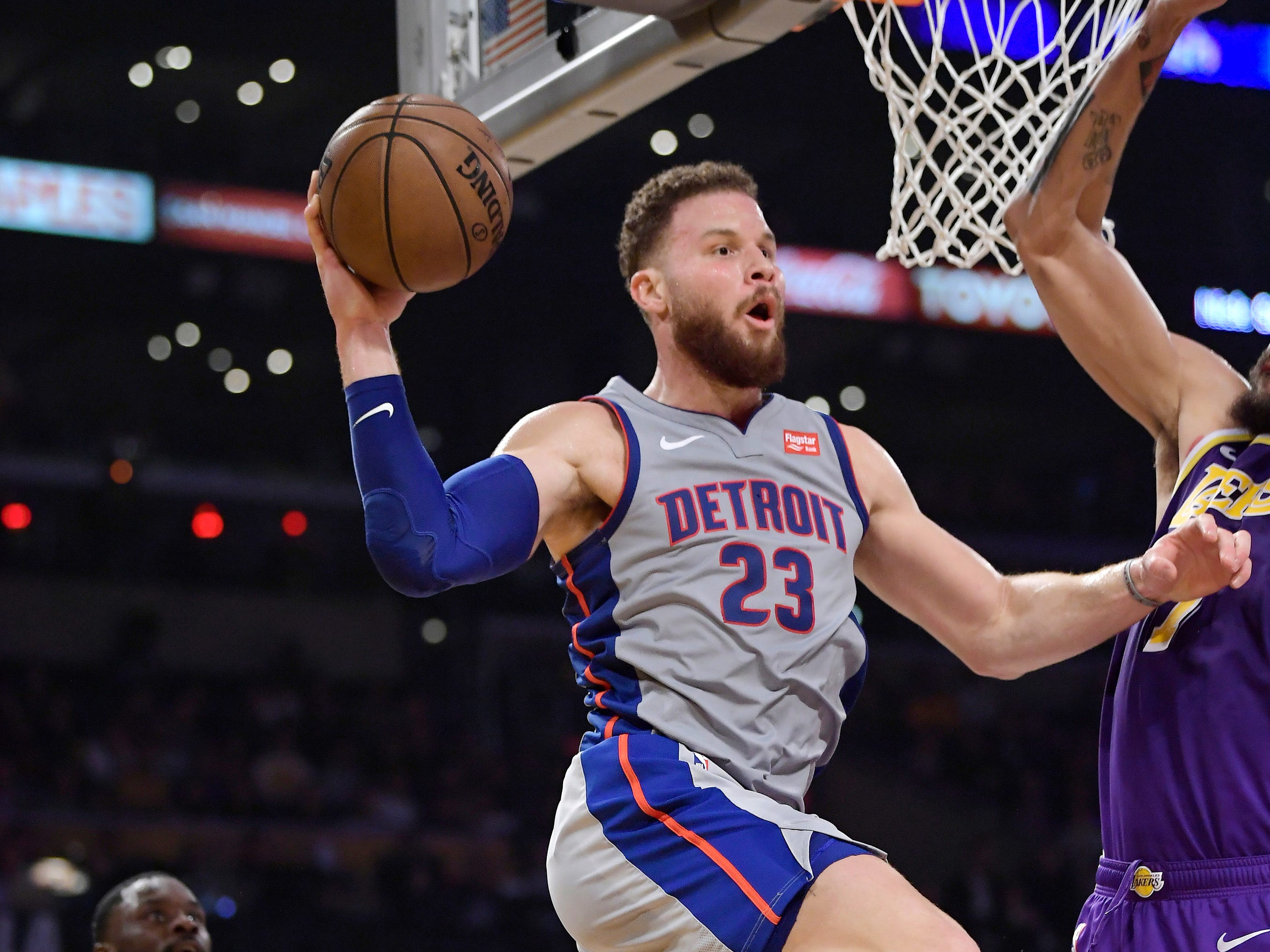 Detroit Pistons forward Blake Griffin looks to pass the ball as Los Angeles Lakers guard Lance Stephenson, left, defends during the first half of an NBA basketball game Wednesday, Jan. 9, 2019, in Los Angeles.