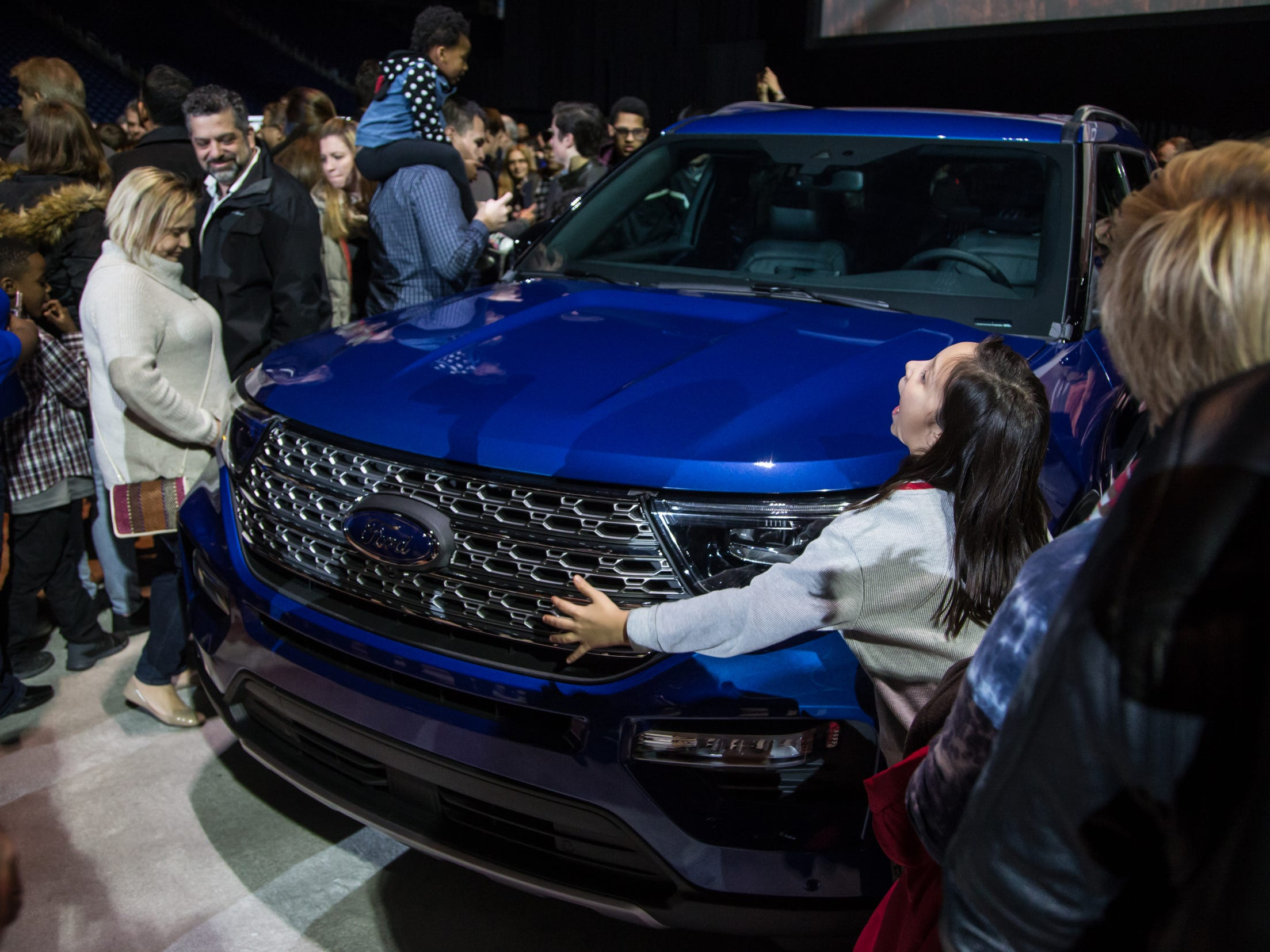 People look over the all new 2020 Ford Explorer during a Ford event at Ford Field in Detroit on Wednesday, January 9, 2019.