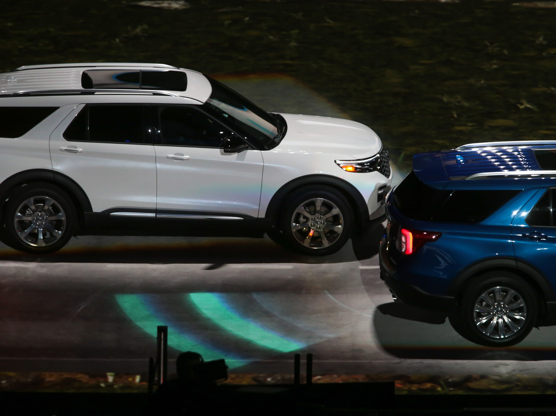 An all new 2020 Ford Explorer drives on the floor during a Ford event at Ford Field in Detroit on Wednesday, January 9, 2019.