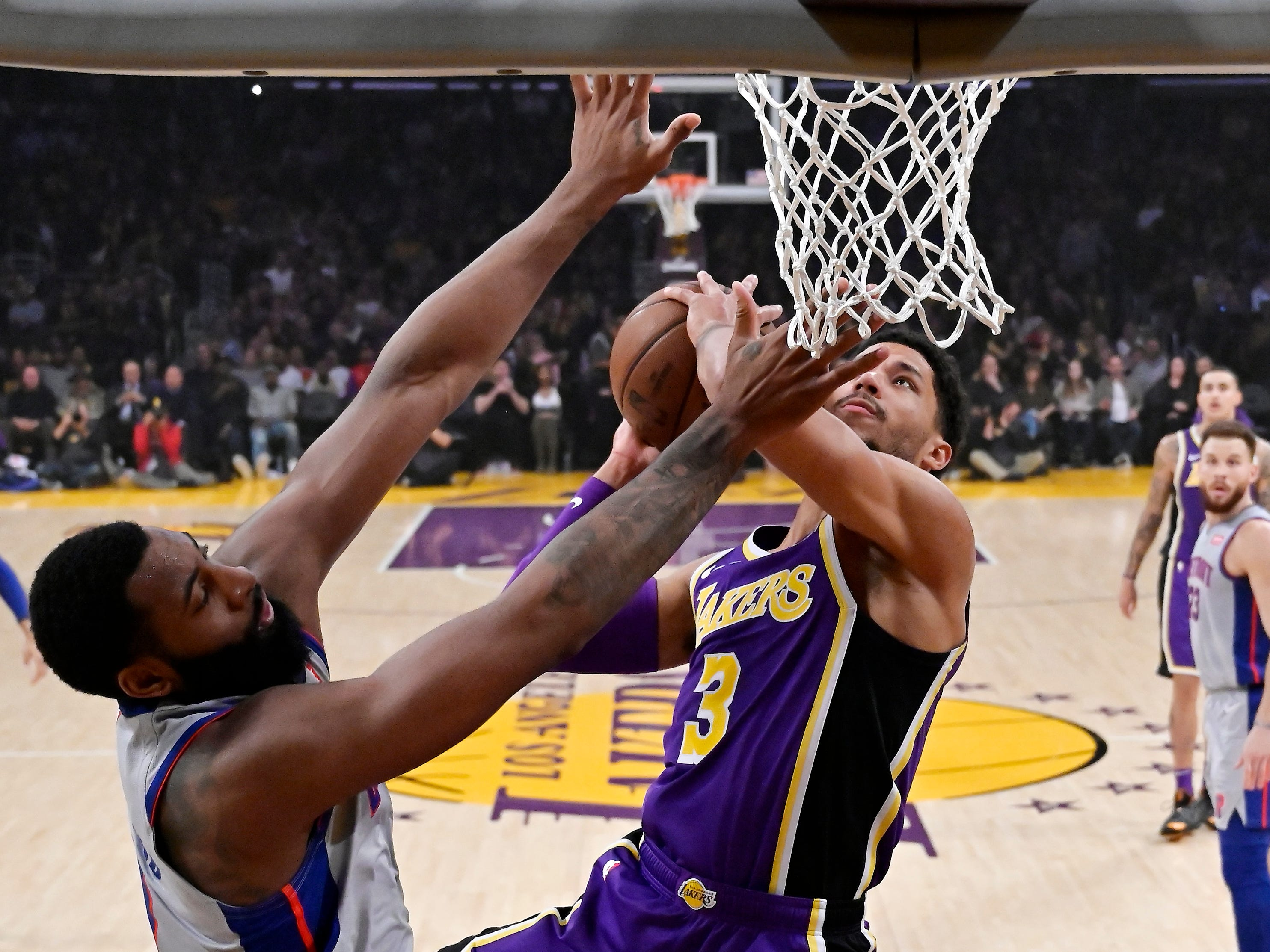 Los Angeles Lakers guard Josh Hart, right, shoots as Detroit Pistons center Andre Drummond defends during the first half of an NBA basketball game Wednesday, Jan. 9, 2019, in Los Angeles.