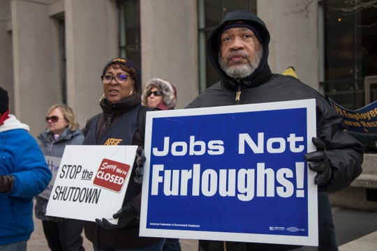 Gregory Simpkins, president of AFGE local 778 and Bertrice Sanders, Social Security Administration Roseville office employee protest the government shutdown outside of the Patrick V. McNamara Federal Building in Detroit, Thursday, Jan. 10, 2019.
