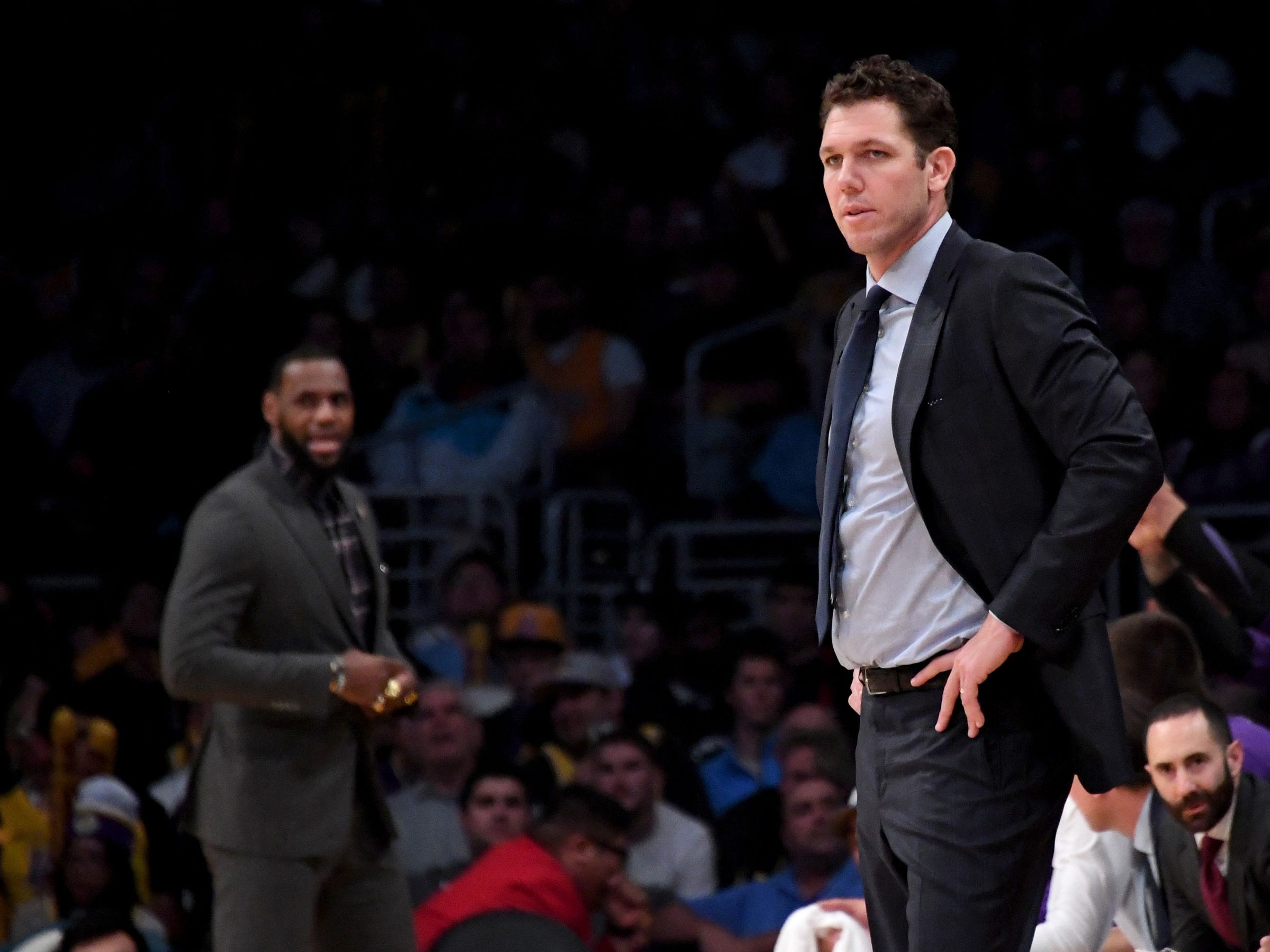 Los Angeles Lakers head coach Luke Walton (right) watches during the second half against the Detroit Pistons at the Staples Center on Wednesday, Jan. 9, 2019, in Los Angeles.