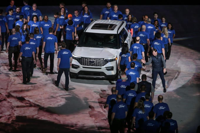 Jim Farley Ford President, Global Markets greets members of the Explorer development team during an unveiling of the all new 2020 Ford Explorer during a Ford event at Ford Field in Detroit on Wednesday, January 9, 2019.