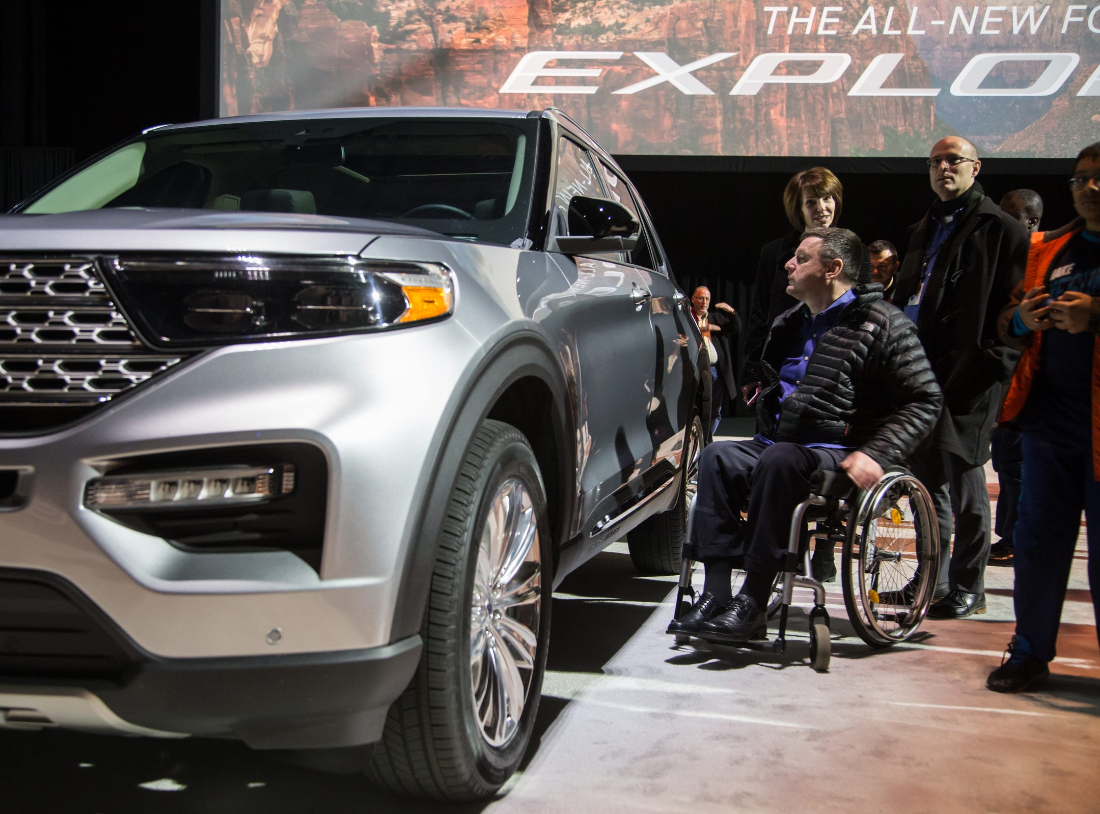 Stefan Sonnenschein Royal Oak looks over an all new 2020 Ford Explorer during a Ford event at Ford Field in Detroit on Wednesday, January 9, 2019.