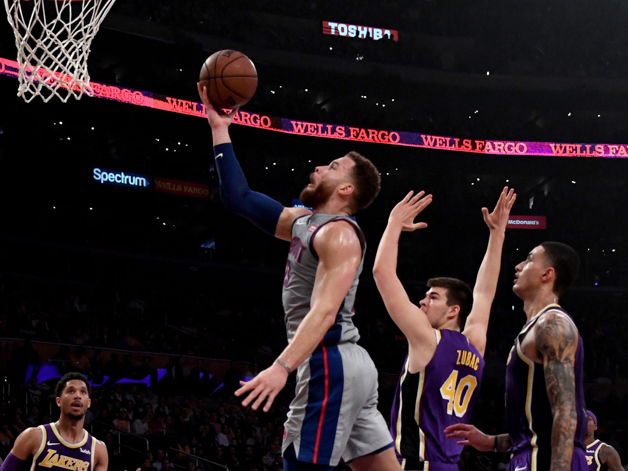 Detroit Pistons forward Blake Griffin (23) drives to the basket past Los Angeles Lakers center Ivica Zubac (40) during the first half at the Staples Center on Wednesday, Jan. 9, 2019, in Los Angeles.
